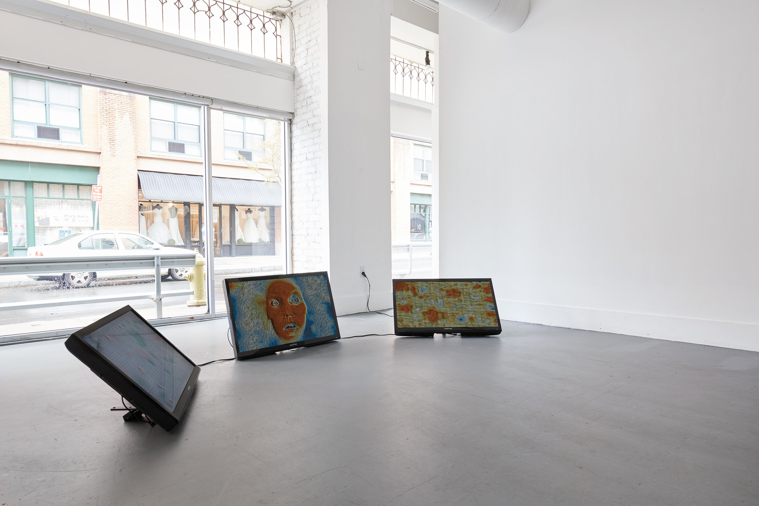 "Aliza Shvarts,  Relational Clocks: I, You, We (installation view),  2018, Custom natural language processing software and data visualization; 3 40"" flat screen monitors; duration approx. 4 years."