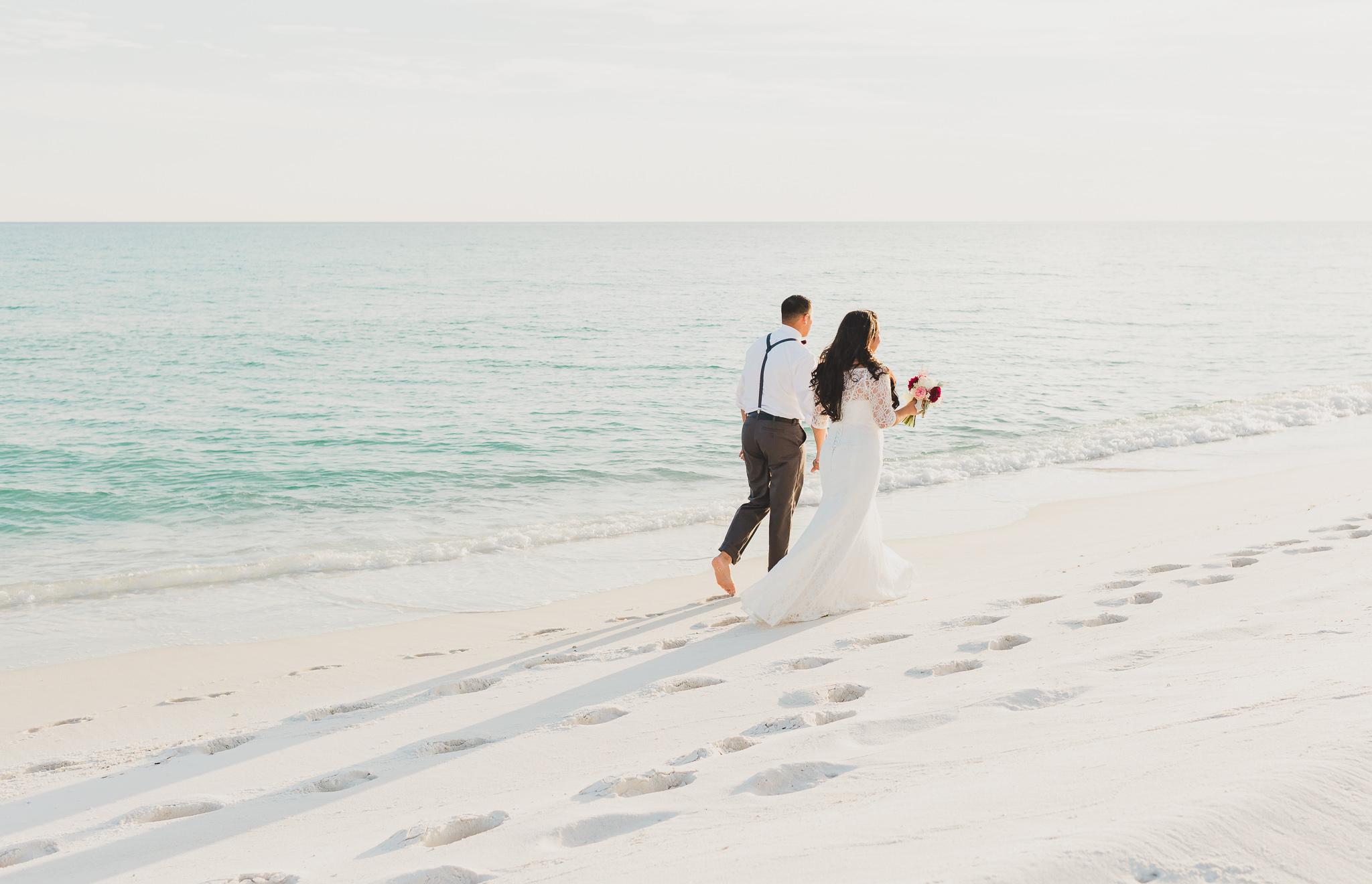 opal beach wedding bride and groom walking pose