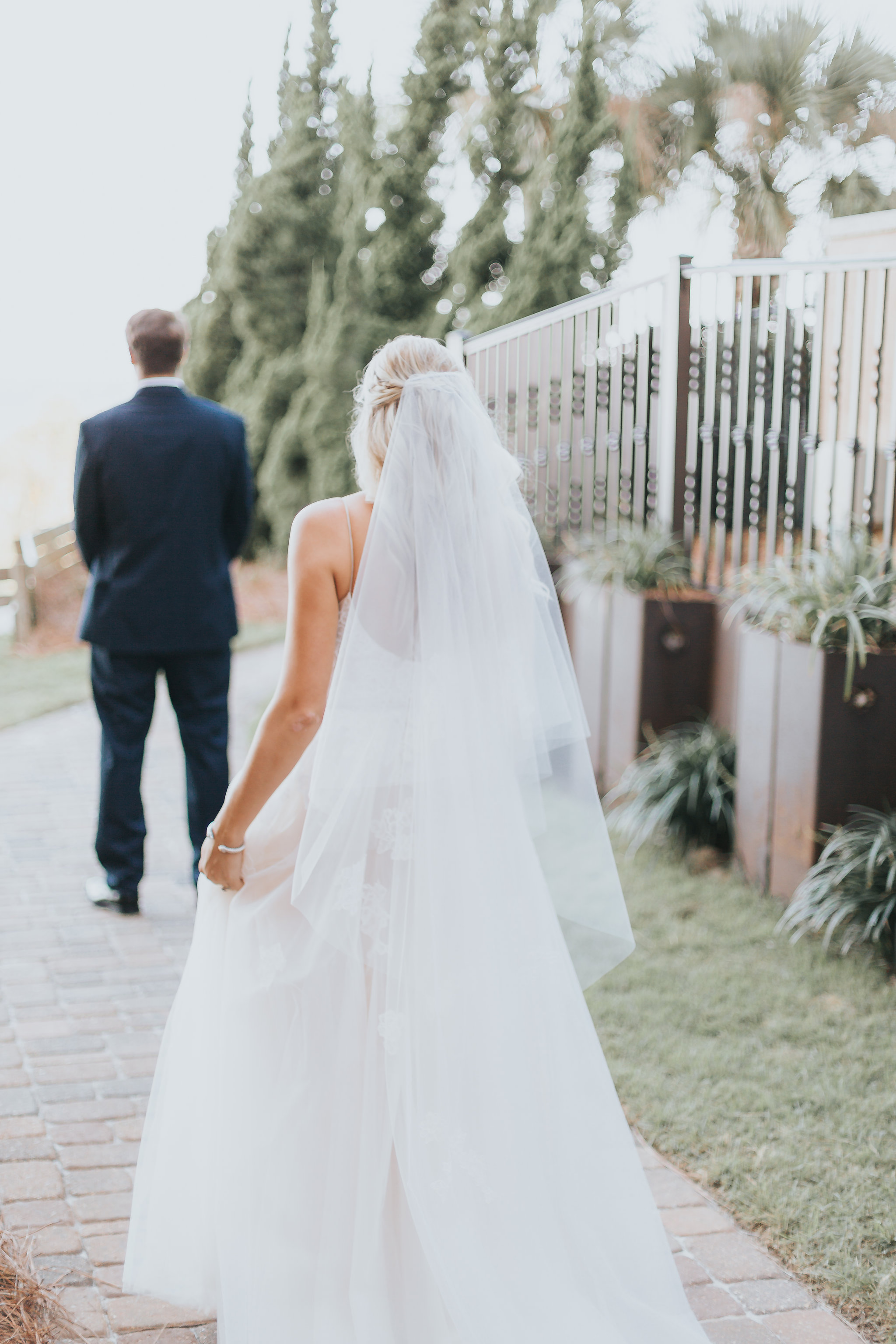 bride walking to groom for first look before portofino wedding in pensacola beach