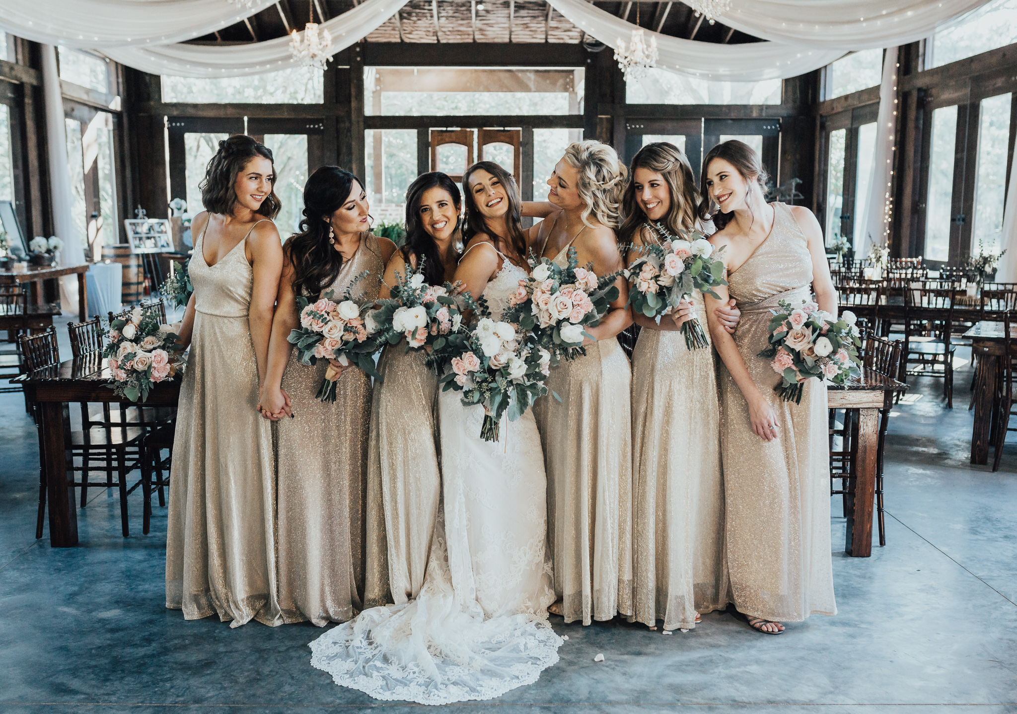 bridesmaids at live oak plantation wedding with lulus gold bridesmaid dresses