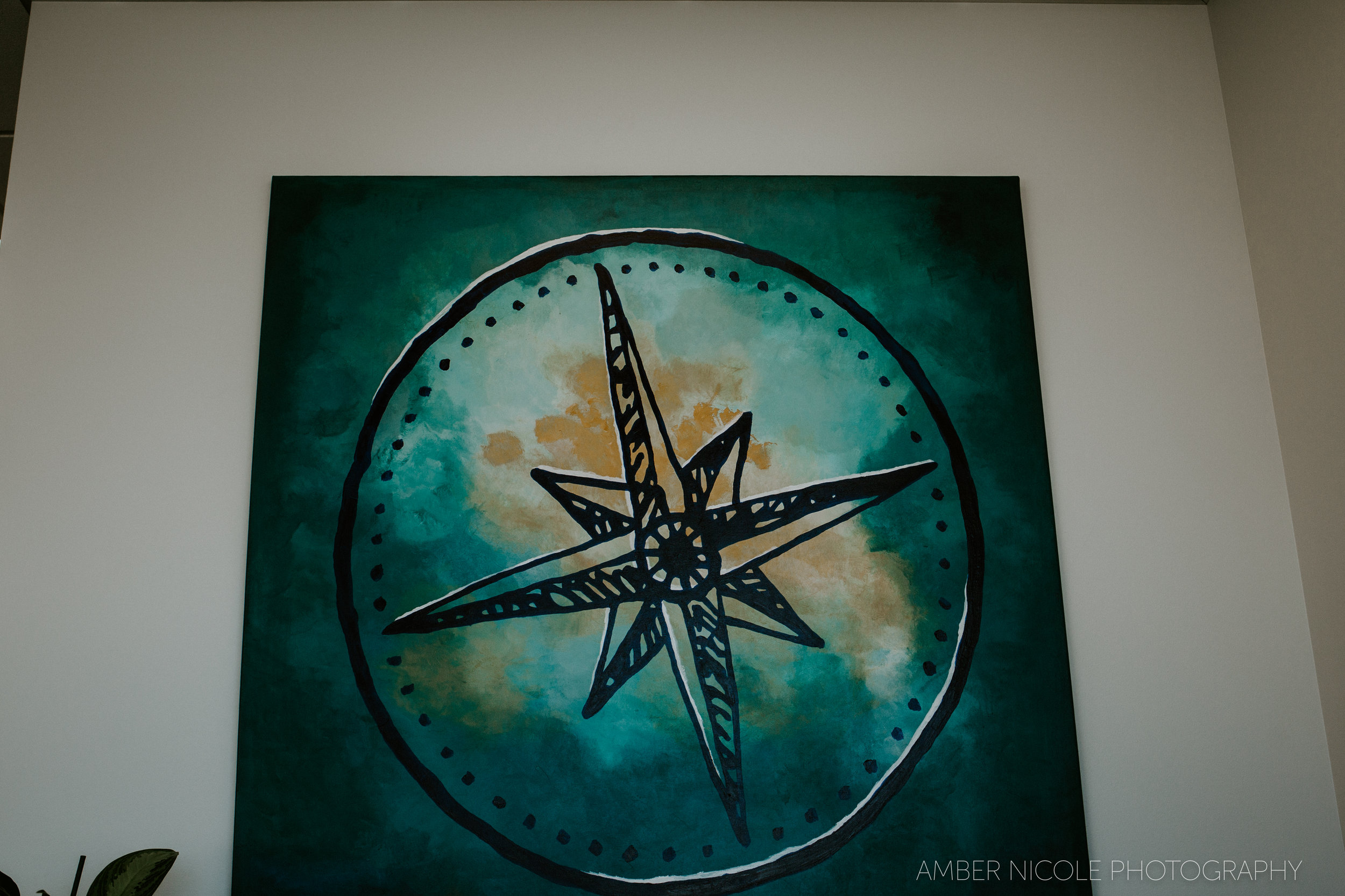 The painting above the back of the front counter. The artist's name is Amanda Ward. Per Aly, she also designed the reception area, as well as was the creator of the logo for the DWC!