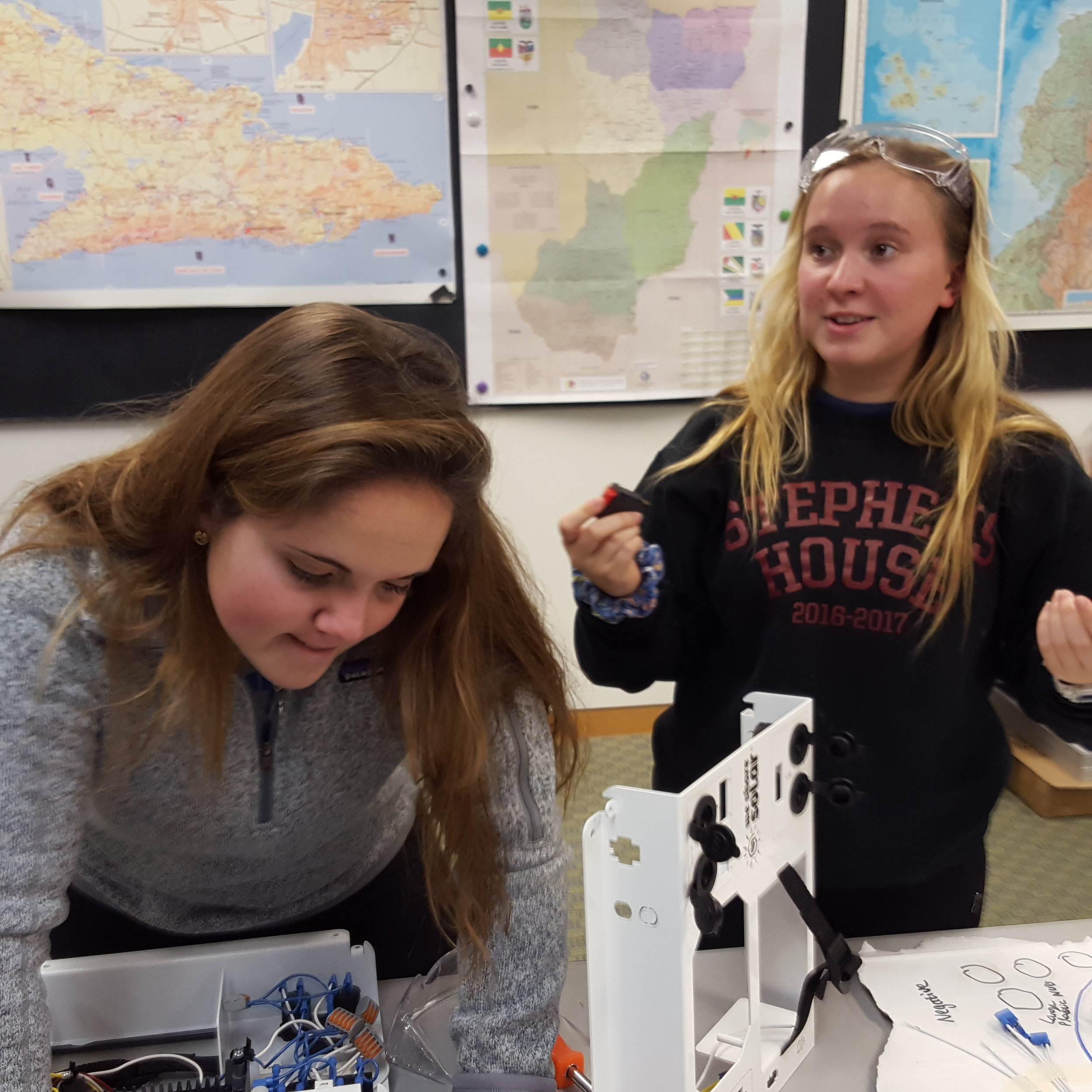 Island School alumnae Kyra Hall (Fall 2016) and Annika Goldman (Spring 2016) putting the solar controller components together to fly with Chris and Pam.