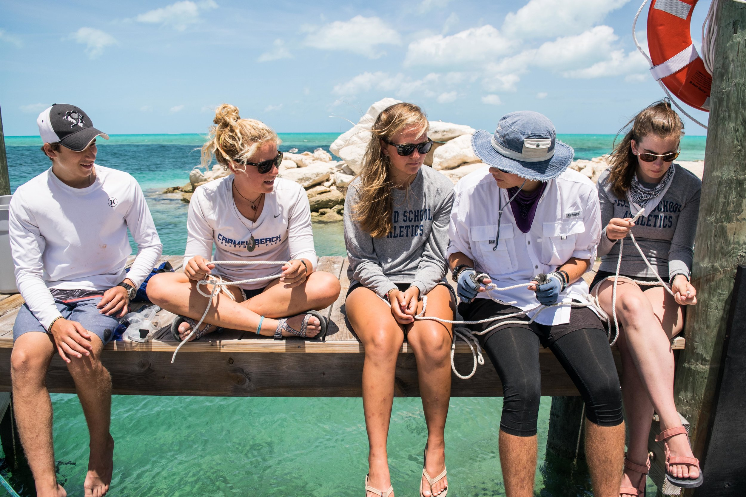 Brad, Alex, Megan, Andrew, and Brenna practice various knots before hopping on their sailboat.
