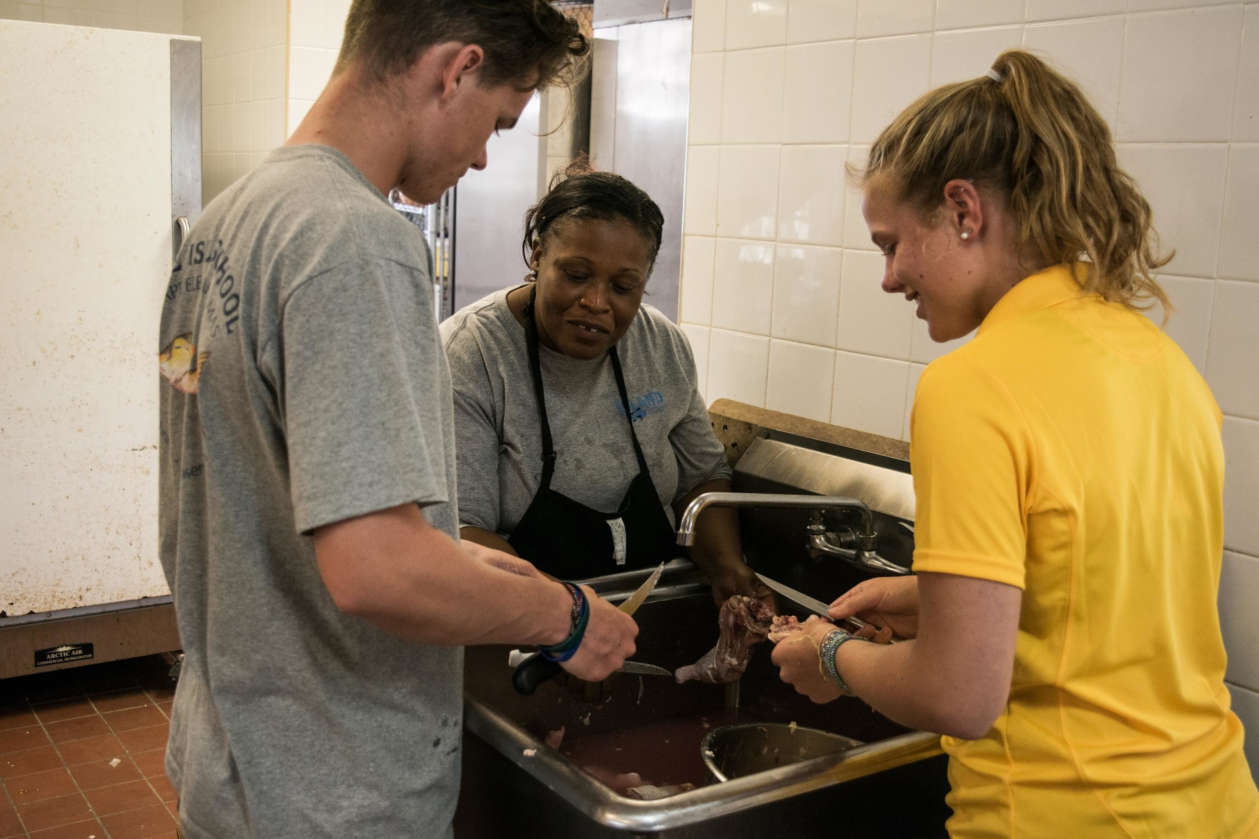 Will Enterline and Laela Lunt helping Oria in the kitchen to prep for dinner.