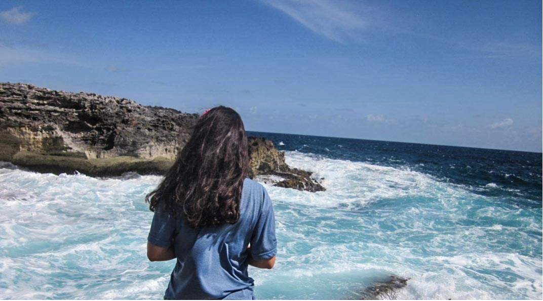 Asha DelCogliano admiring the frothing Atlantic while on her Down Island Trip.