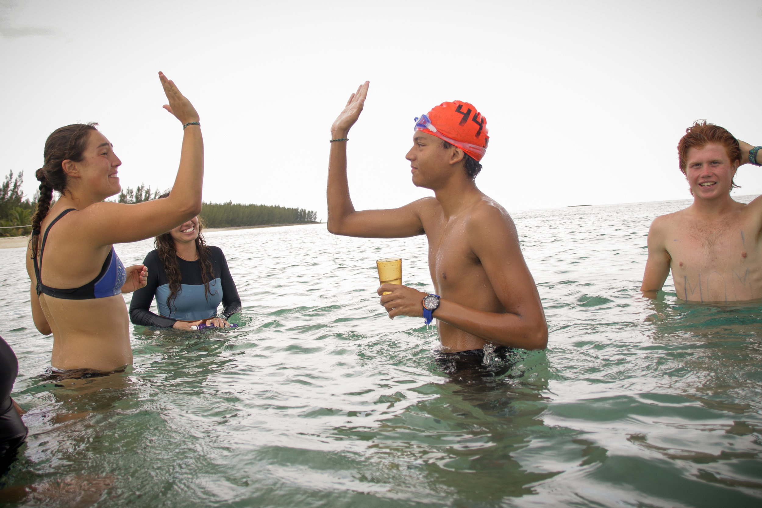 Donavan Hepburn, student, celebrating with Lizzy, his Histories teacher, both of whom completed the four mile Super Swim.