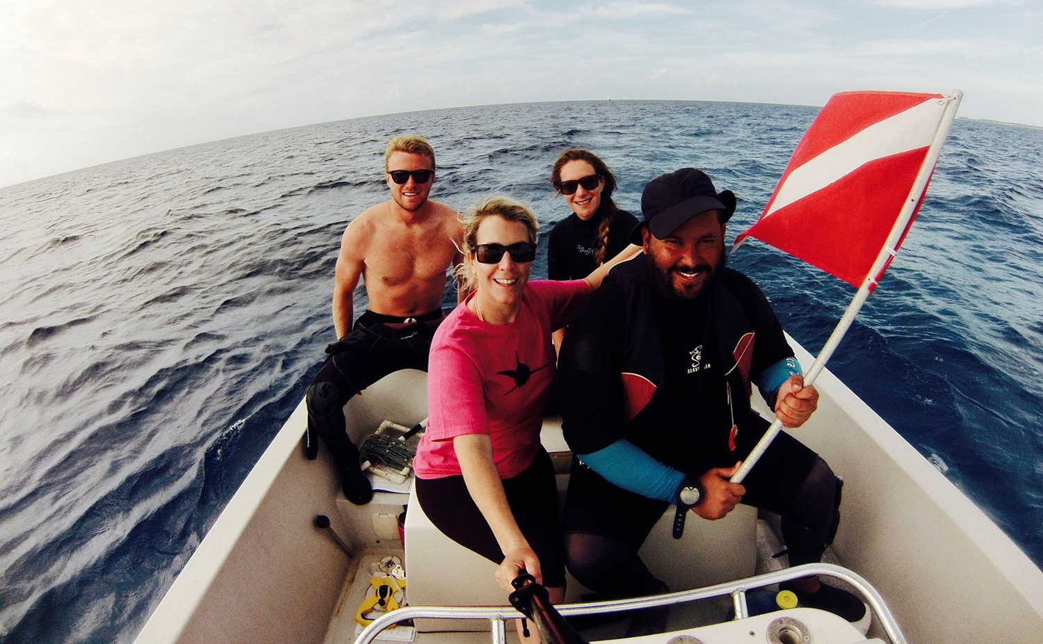 The South Eleuthera AGRRA team. (Left to right) Drew Hitchner (CEI), Hayley Jo Carr (Stuart's Cove), Candice Brittain (CEI), Lindy Knowles (Bahamas National Trust) (Photo by Hayley Jo Carr)