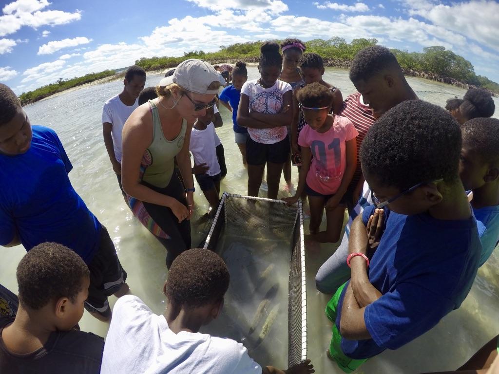 Students prepare to release tagged bonefish in Half Sound.