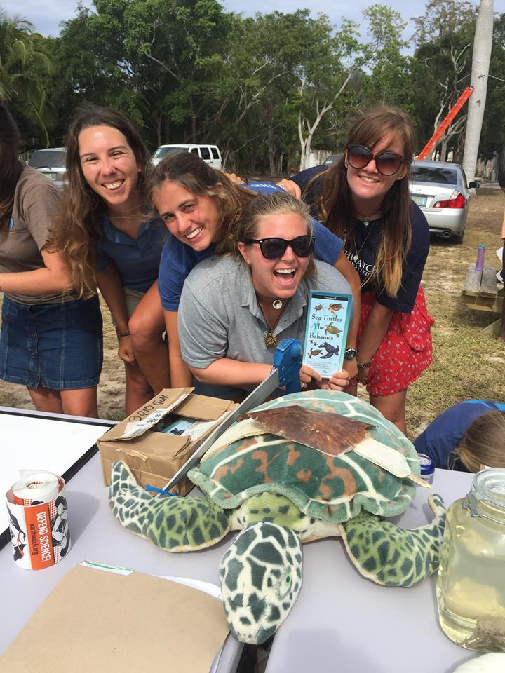 The CEI Turtle Team interns and graduate students pose with their team mascot and educational props.