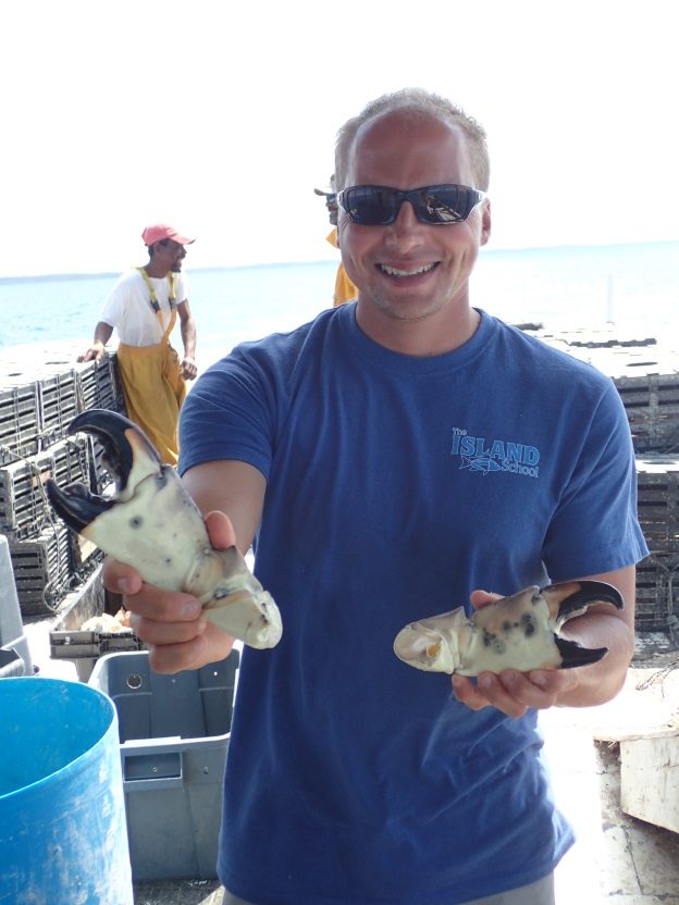 Dr. Travis Van Leeuwen holds some of the crab claws harvested in North Eleuthera.