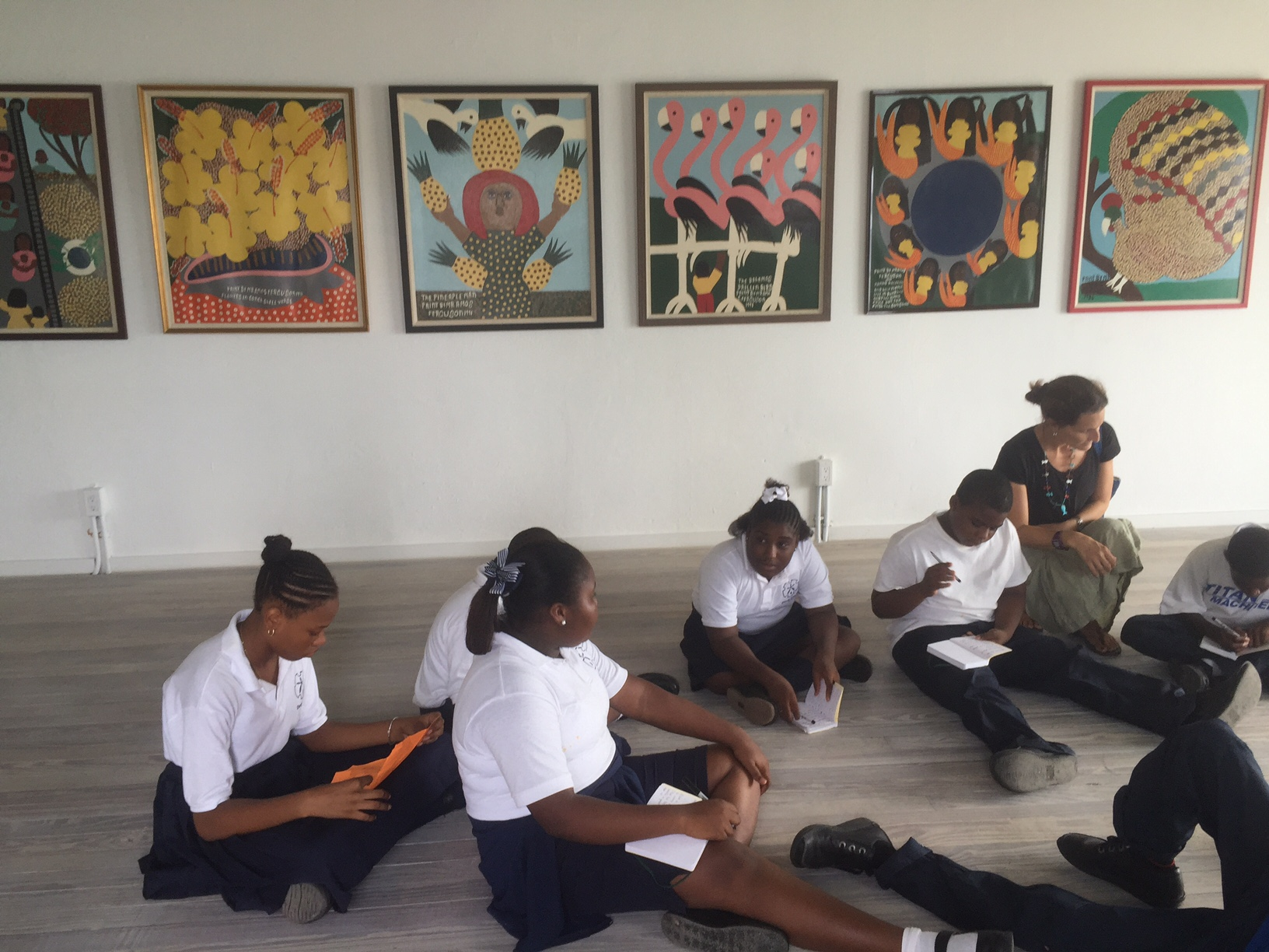 Students in Governor's Harbour reflecting on the artwork by Amos Ferguson.