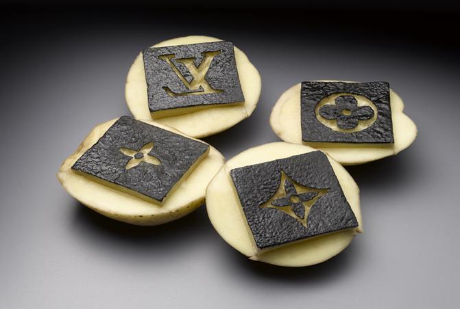 Yumi Janairo Roth,  Potato Stamp Louis Vuitton , 2010. Archival print of carved potatoes