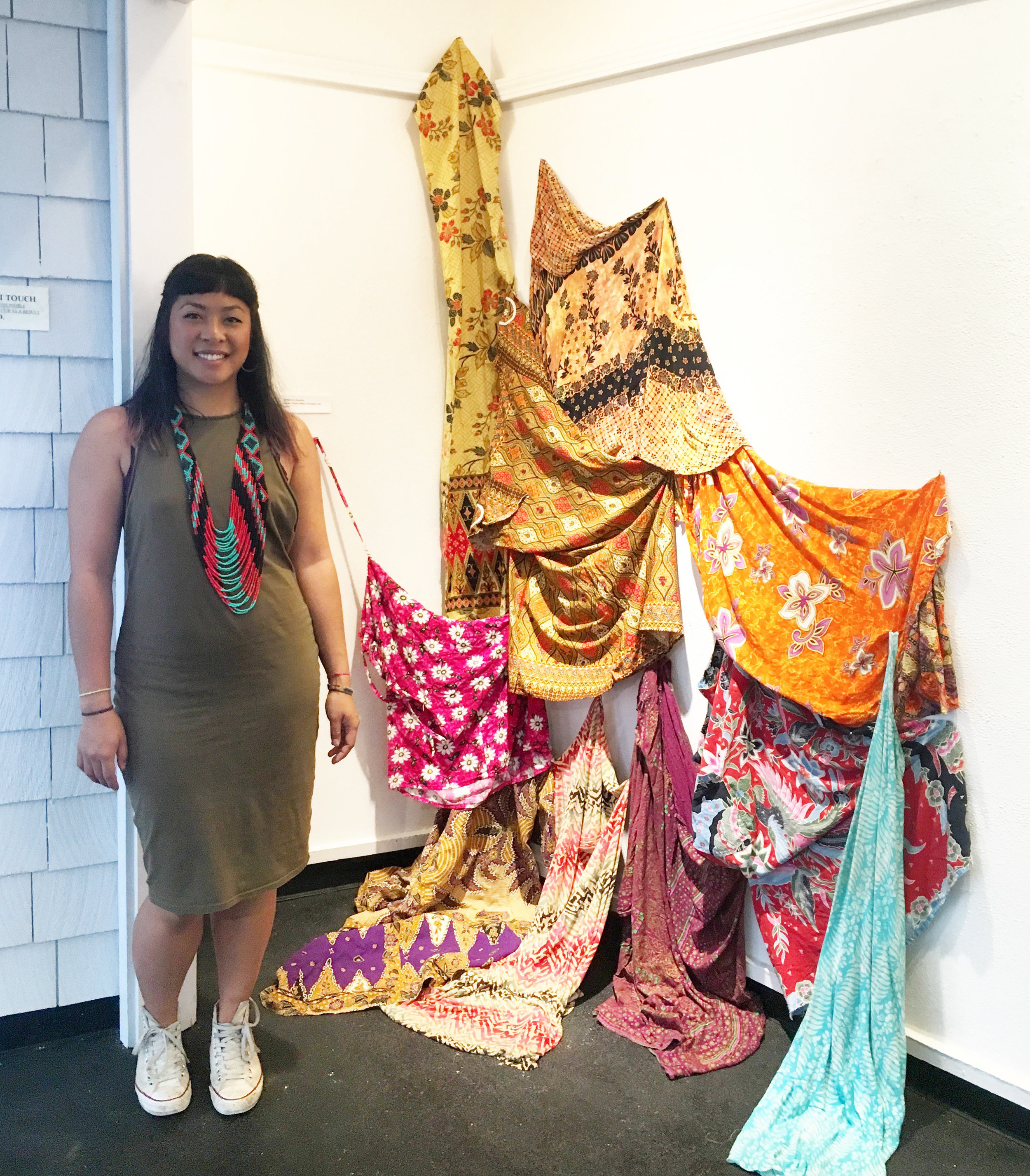 Kimberley Acebo Arteche with her work at Wailoa Arts & Cultural Center in Hilo, Hawaii. Photo by Janna Añonuevo Langholz