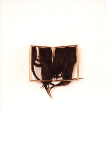 "Nicole Gervacio, ""sisters"". Human hair in found frame, 7""x11""."