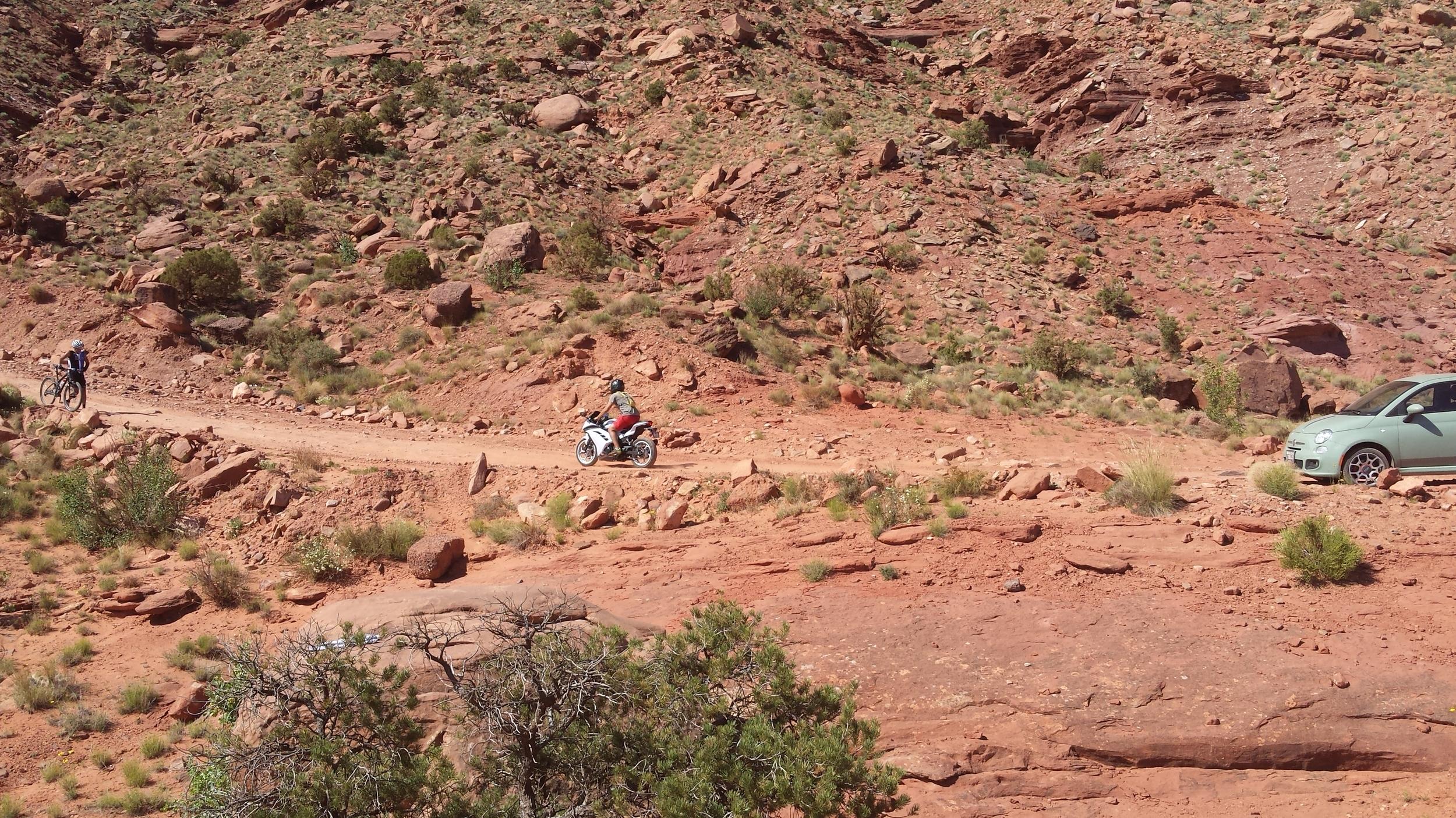 Benjamin off-roading on his baby street bike.