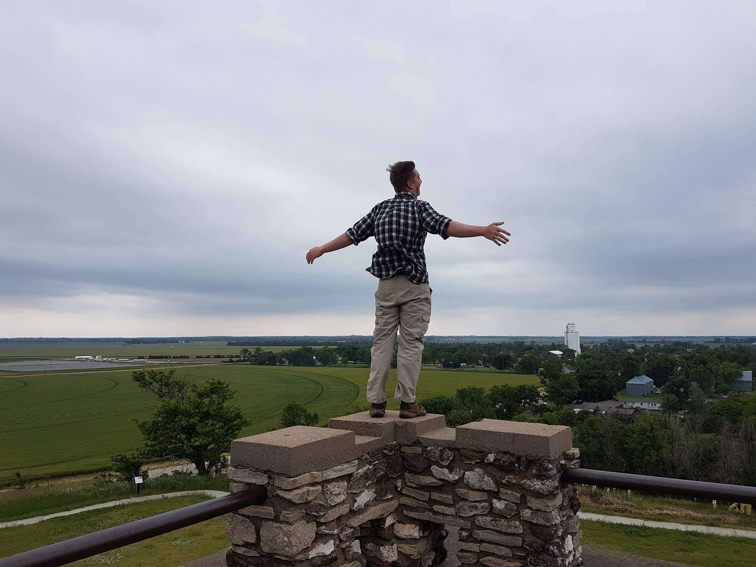 Iain feeling the breeze above Pawnee Rock, KS, just before our final leg home.