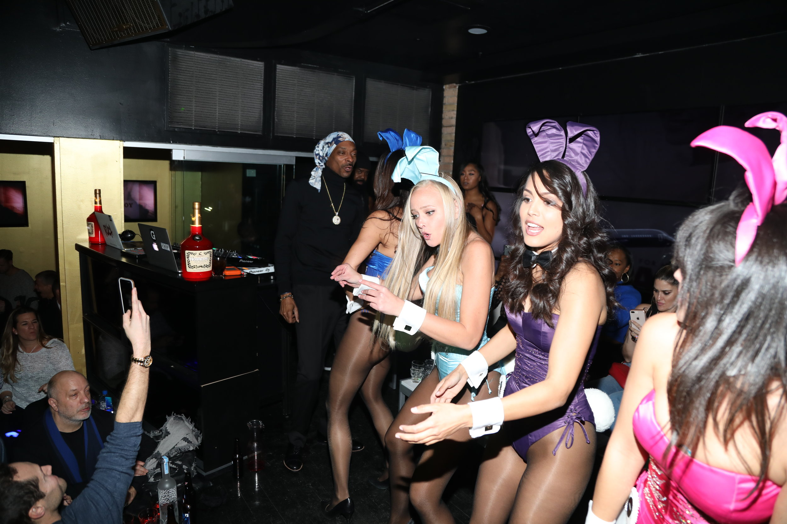 Snoop Dogg performs with Playmates at Playboy's Big Game Party