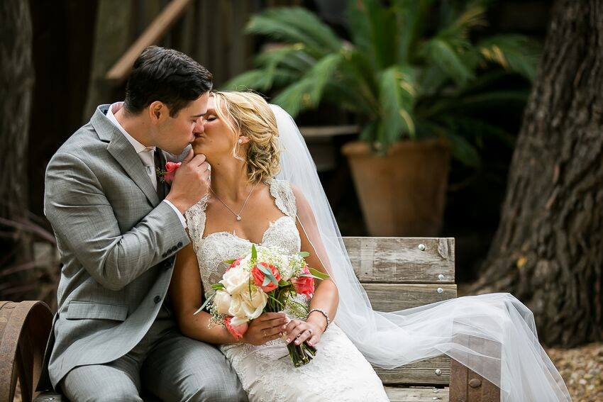orange county wedding event planner couple kissing