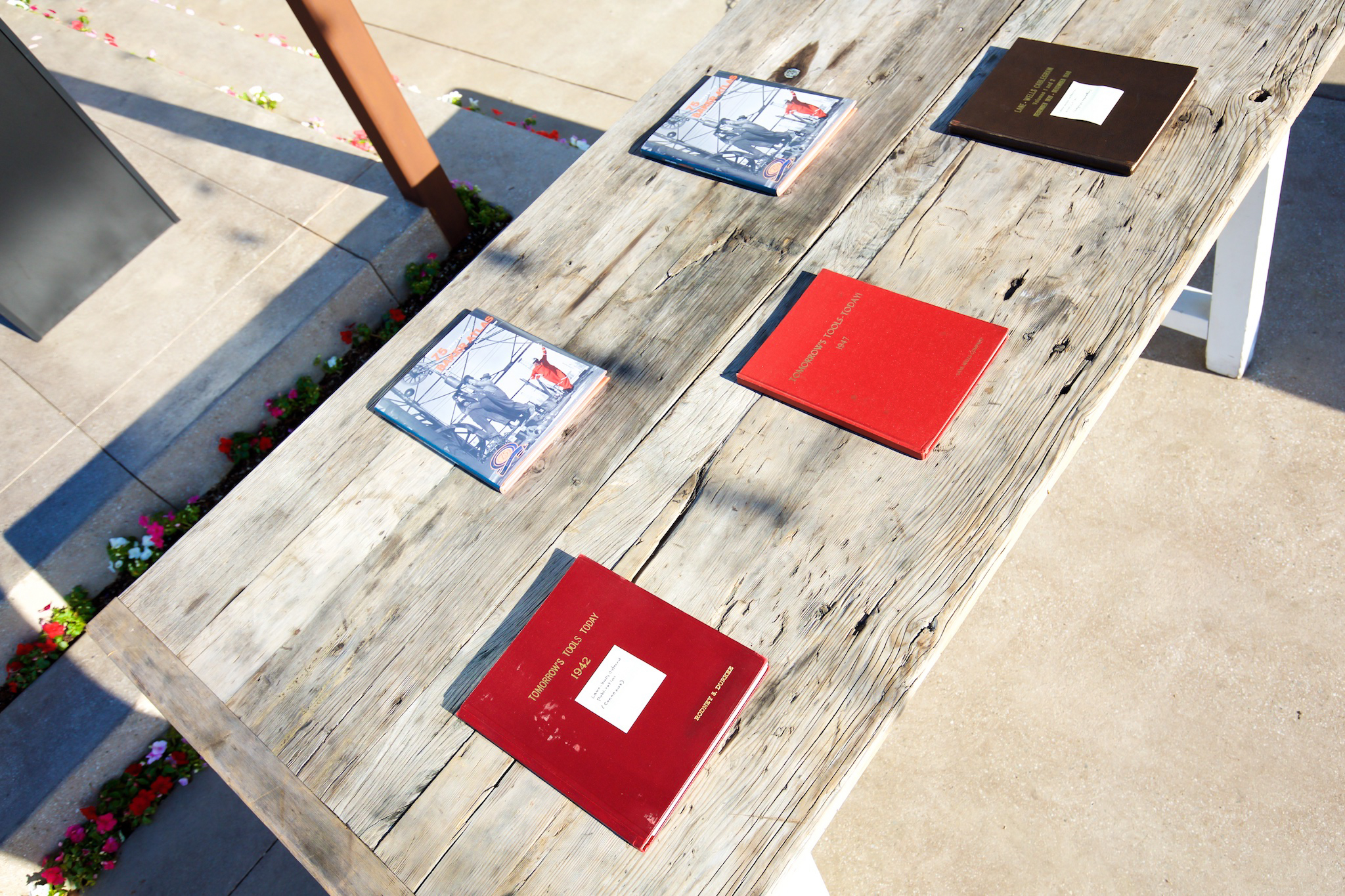 orange county corporate event planner books wood table