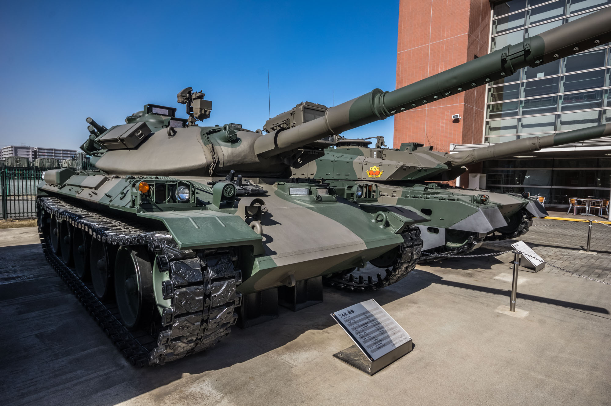 A Type 74 MBT (left) and Type 10 MBT (right)