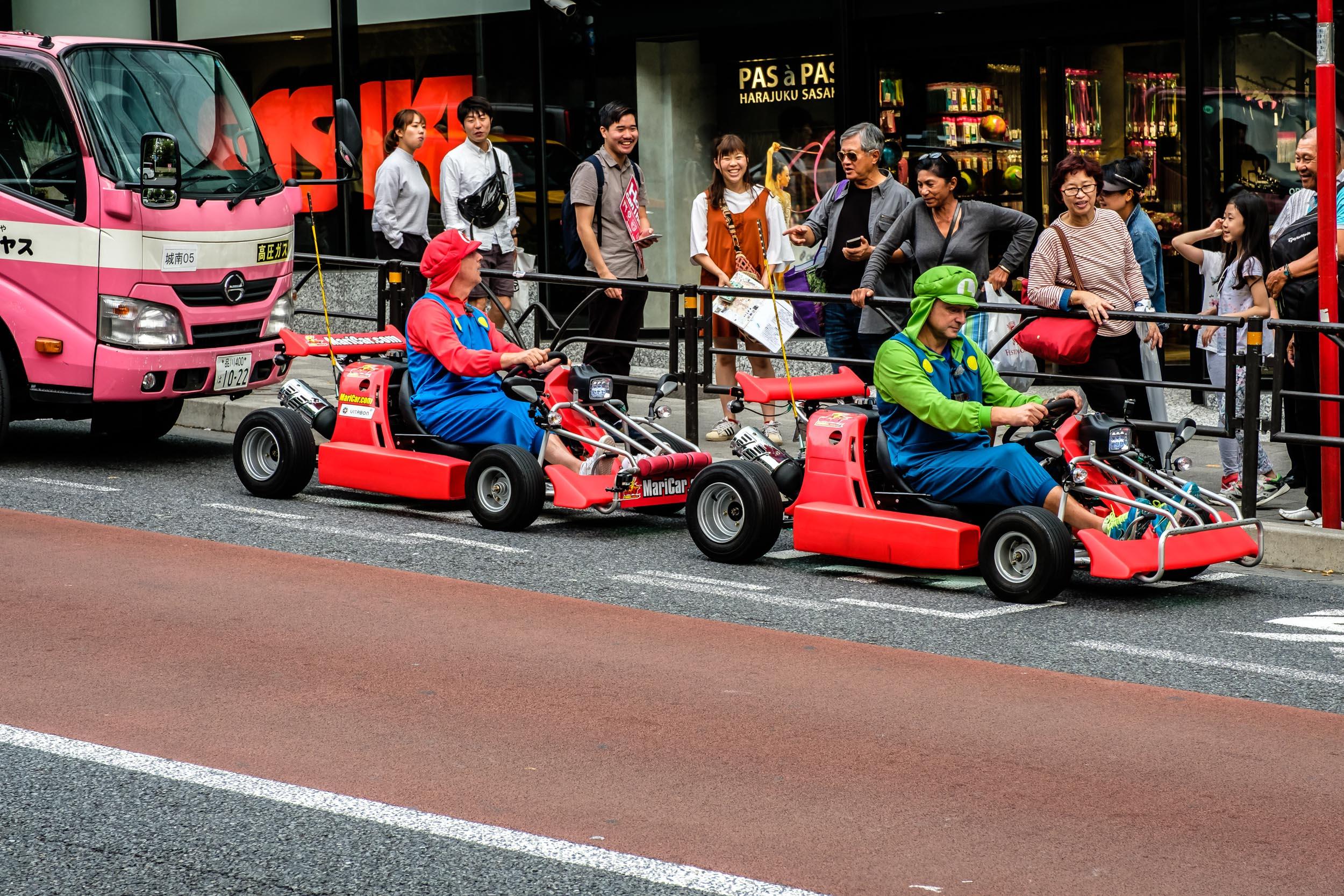 Two Marios karting in Harajuku