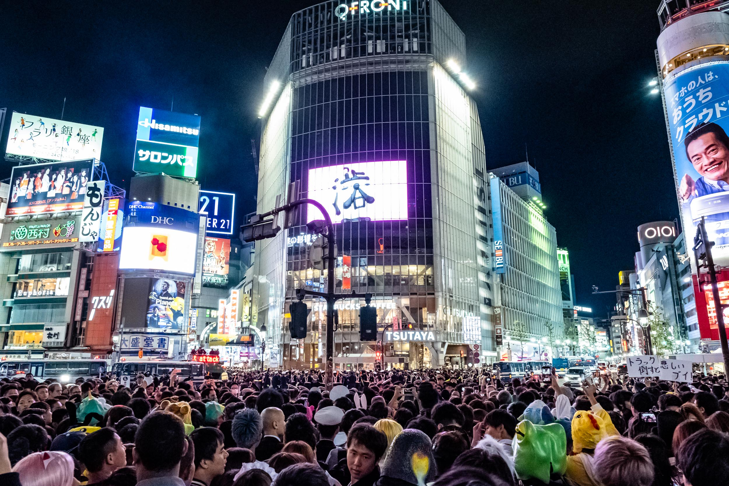 A sea of people in front of Shibuya Station trying to get over the famous crossing