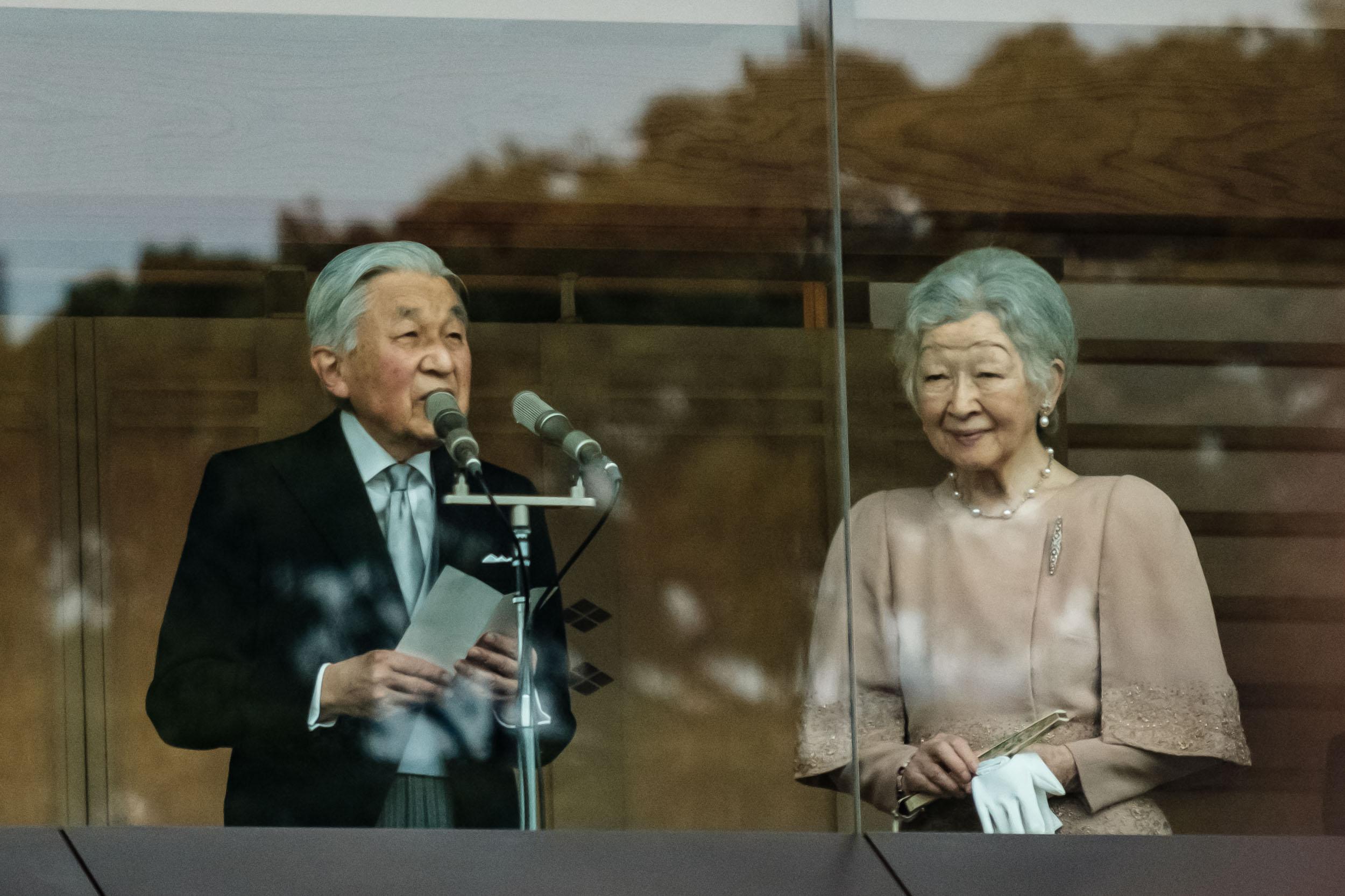 Emperor Akihito making his speech while Empress Michiko looks upon