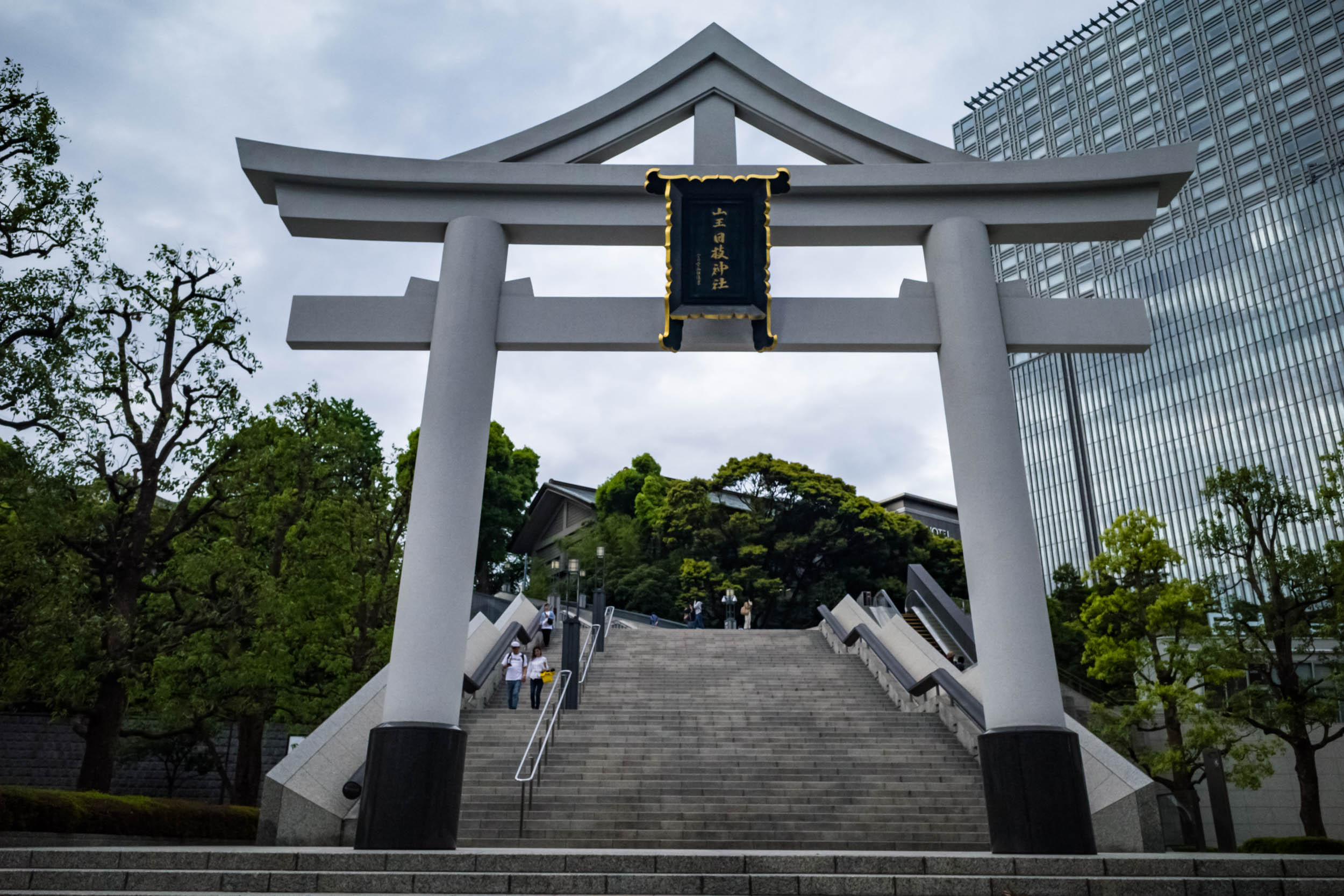 The torii at the main entrance with the escalator on the right