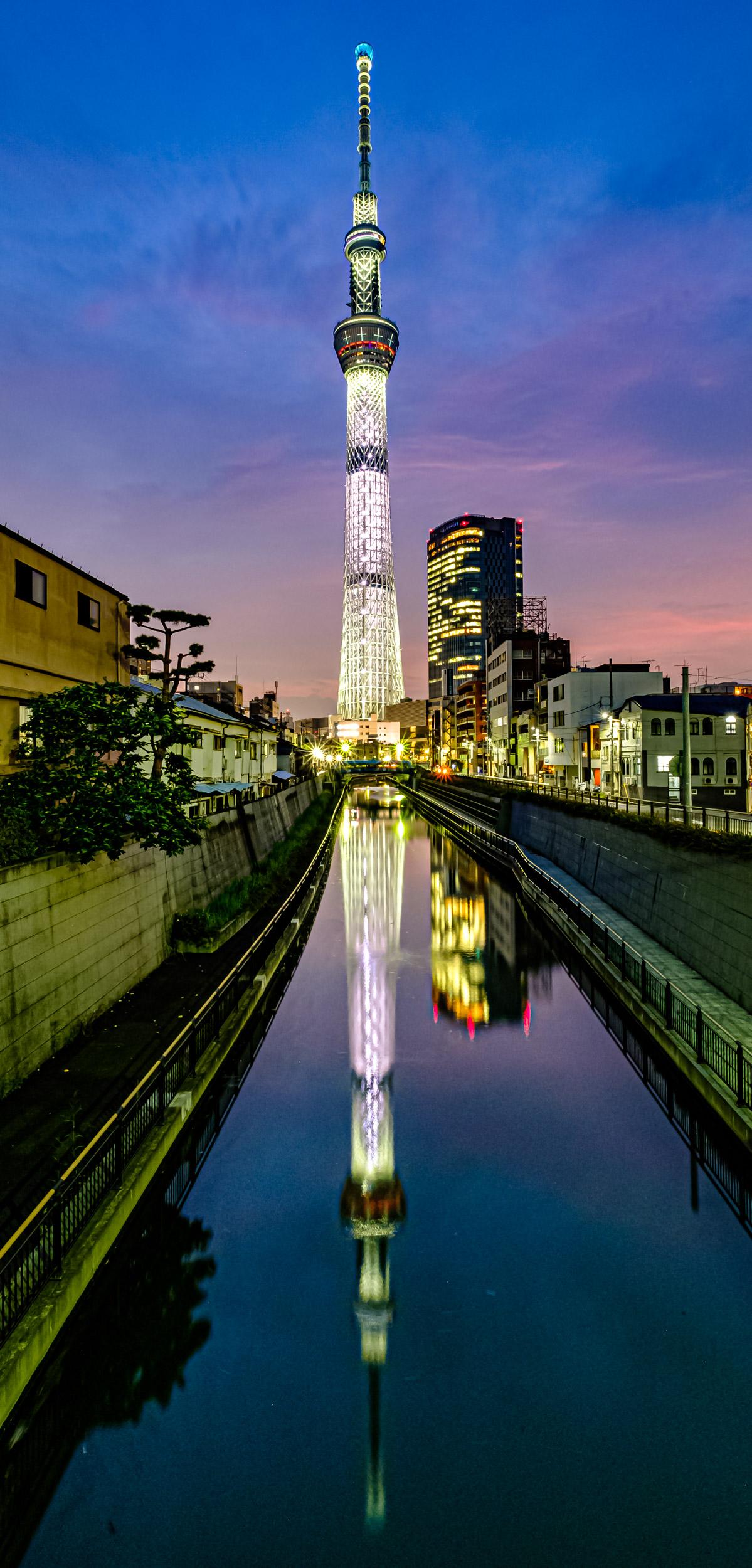The full reflection of Tokyo Skytree in Kitajukken river