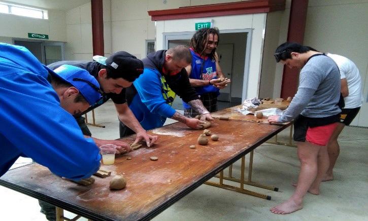 Making Uku (clay flute)
