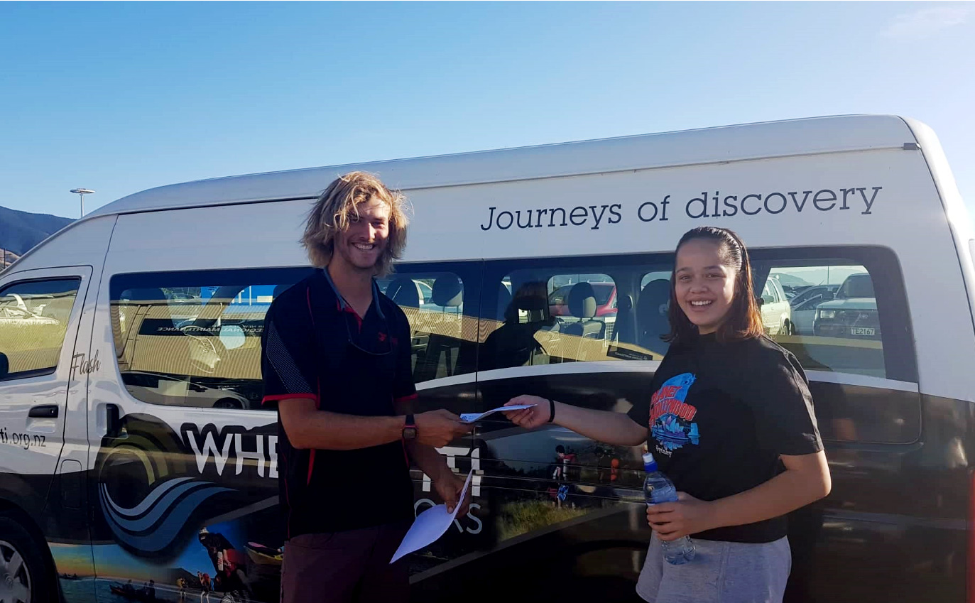 Waimaria donating the $150 car wash money she raised to Whenua-Iti