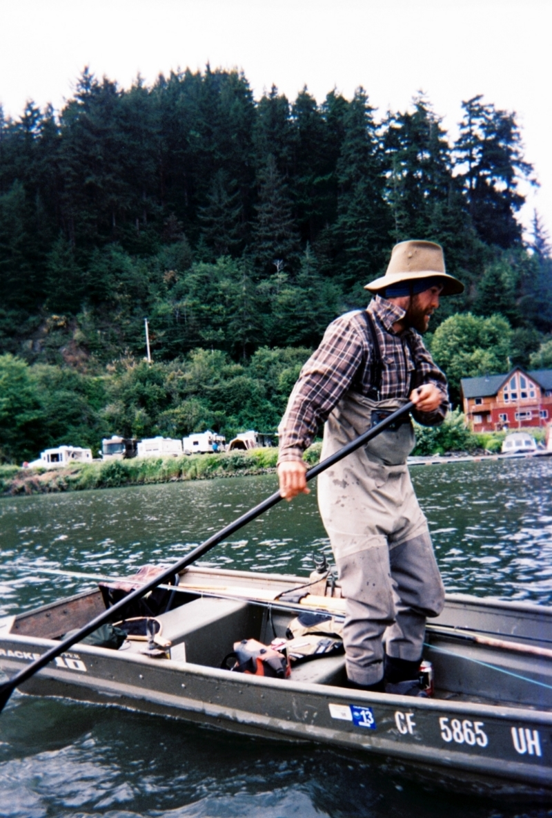 Neil rows out to the far seam with Gold river lodge and the rv armada in the background