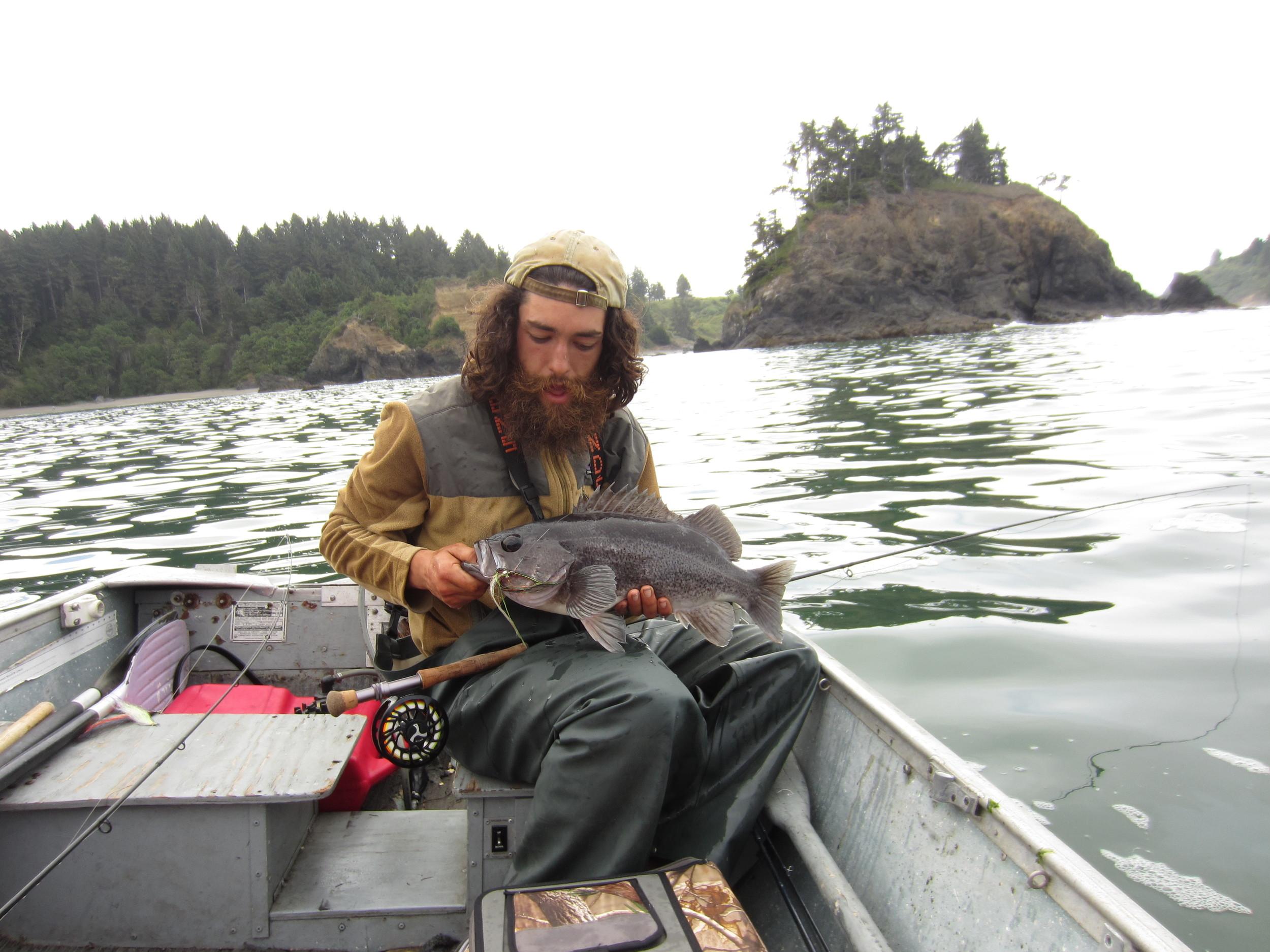 Neil with an epic black caught offshore. Photo Neil Montgrain