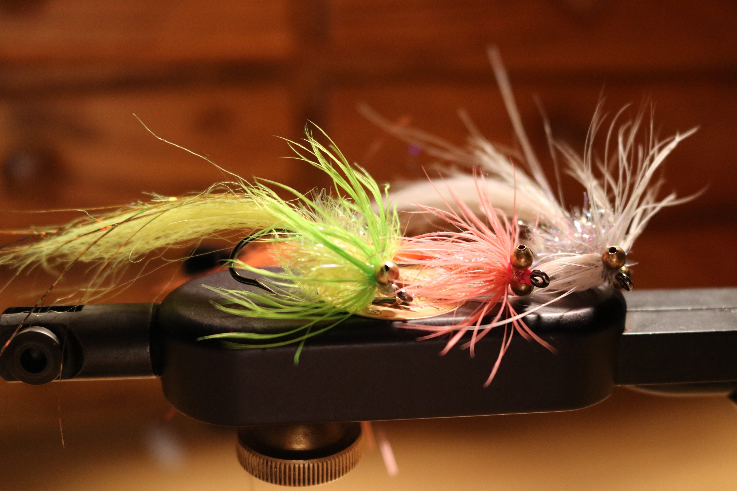 A box full of these will do you for the coast. Pink was the most effective pattern followed closely by chartreuse. I tied up a few white ones for the change up.