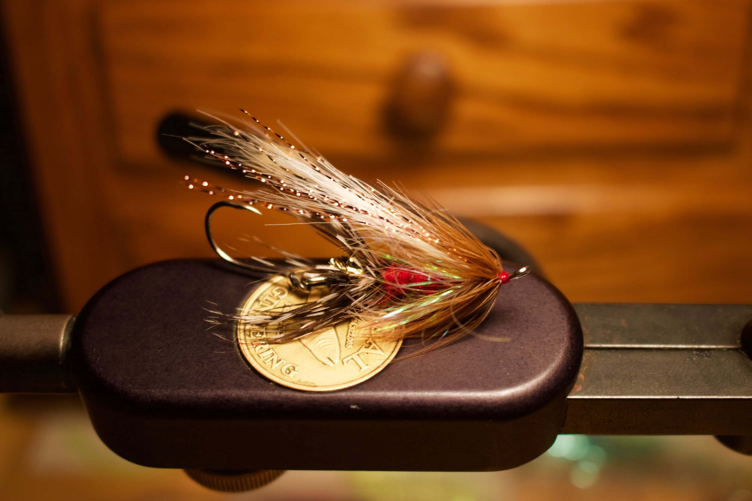A variation of the vaunted Royal Coachman. This pattern was one of the original steelhead flies on the west-coast, along with the now little remembered Parmachene Belle and Thor. It still gets em! Tied on a 35mm Partridge shank with a Sz4 owner on the business end.
