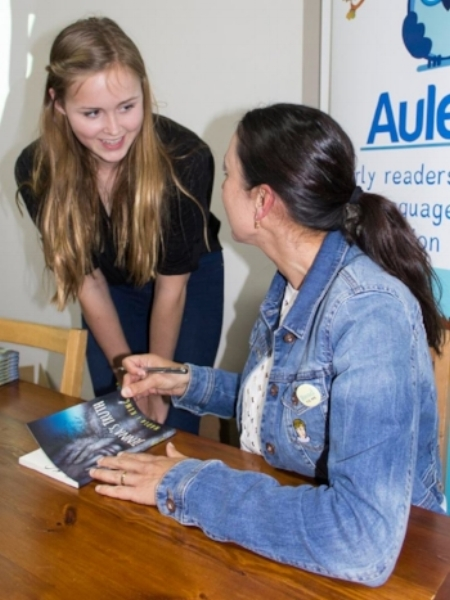 Nadia L King signing