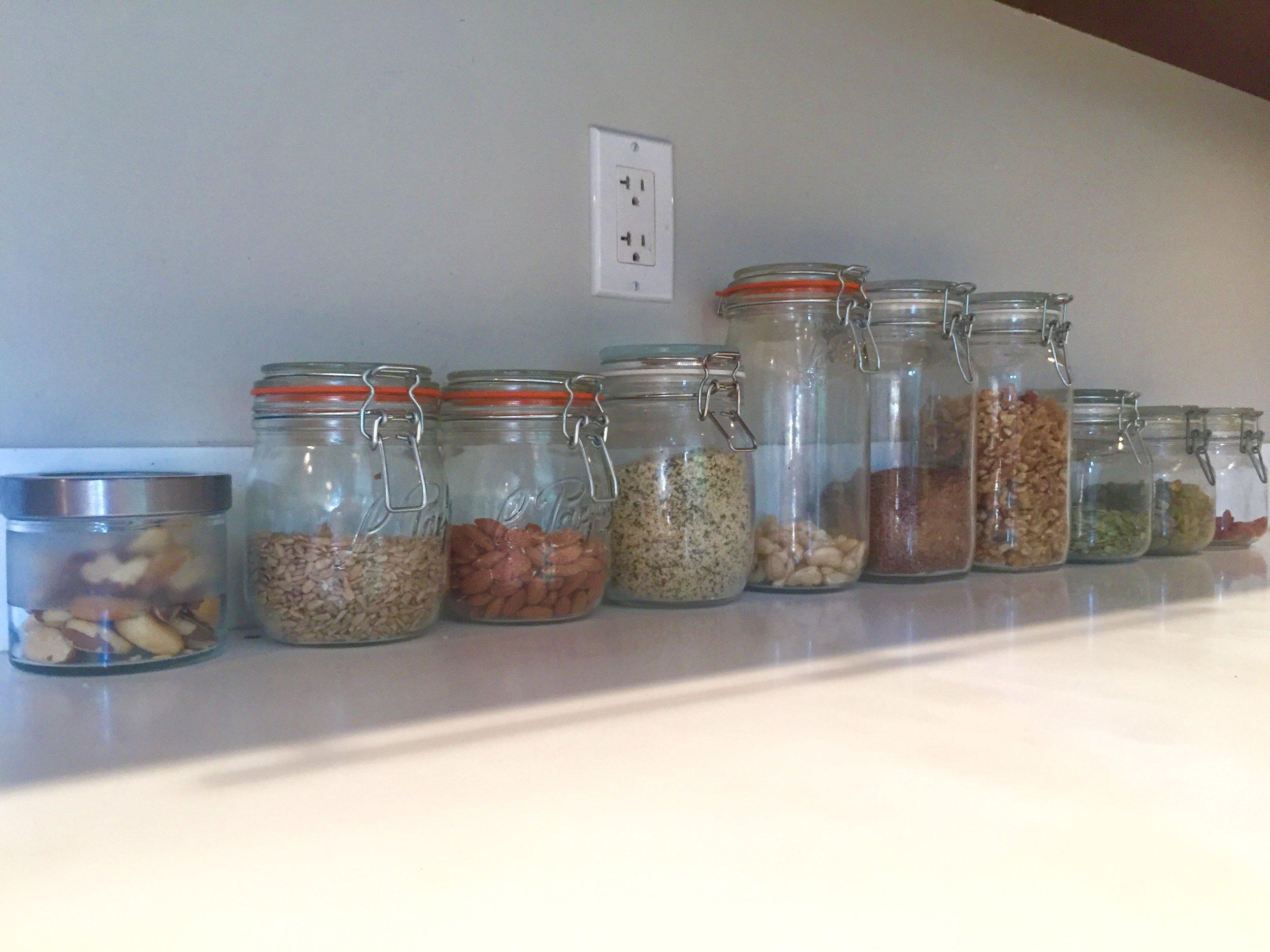 L-R: brazil nuts, sunflower seeds, almonds, hemp seeds, cashews, flax seeds, walnuts, pumpkin seeds, pistachios, goji berries.
