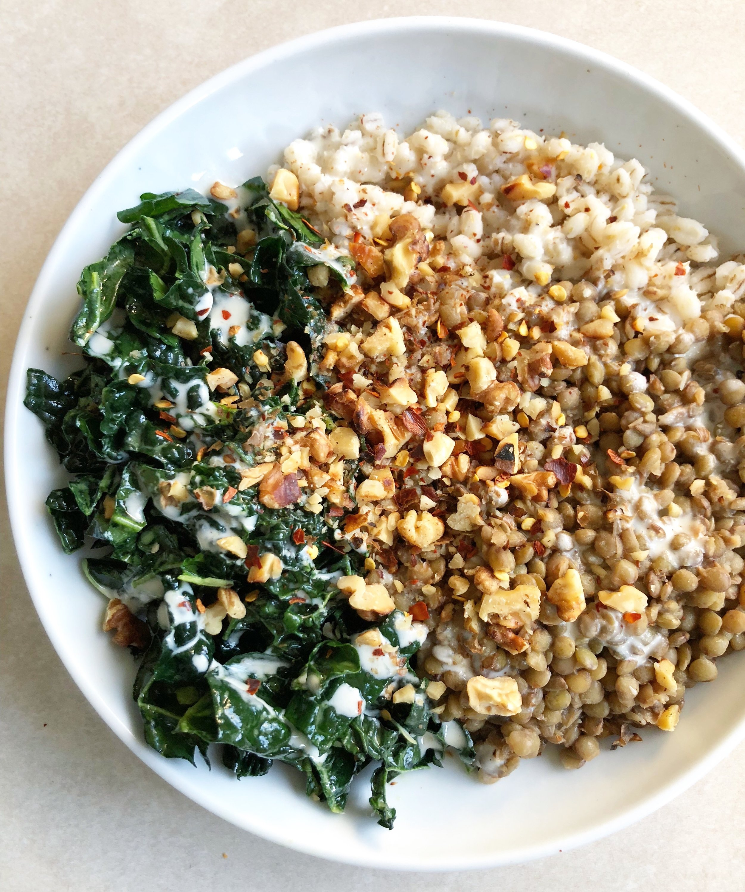 French lentils in garlicky red wine vinaigrette, with barley, kale salad, toasted walnuts, tahini-lemon sauce, chilli flakes, S&P.