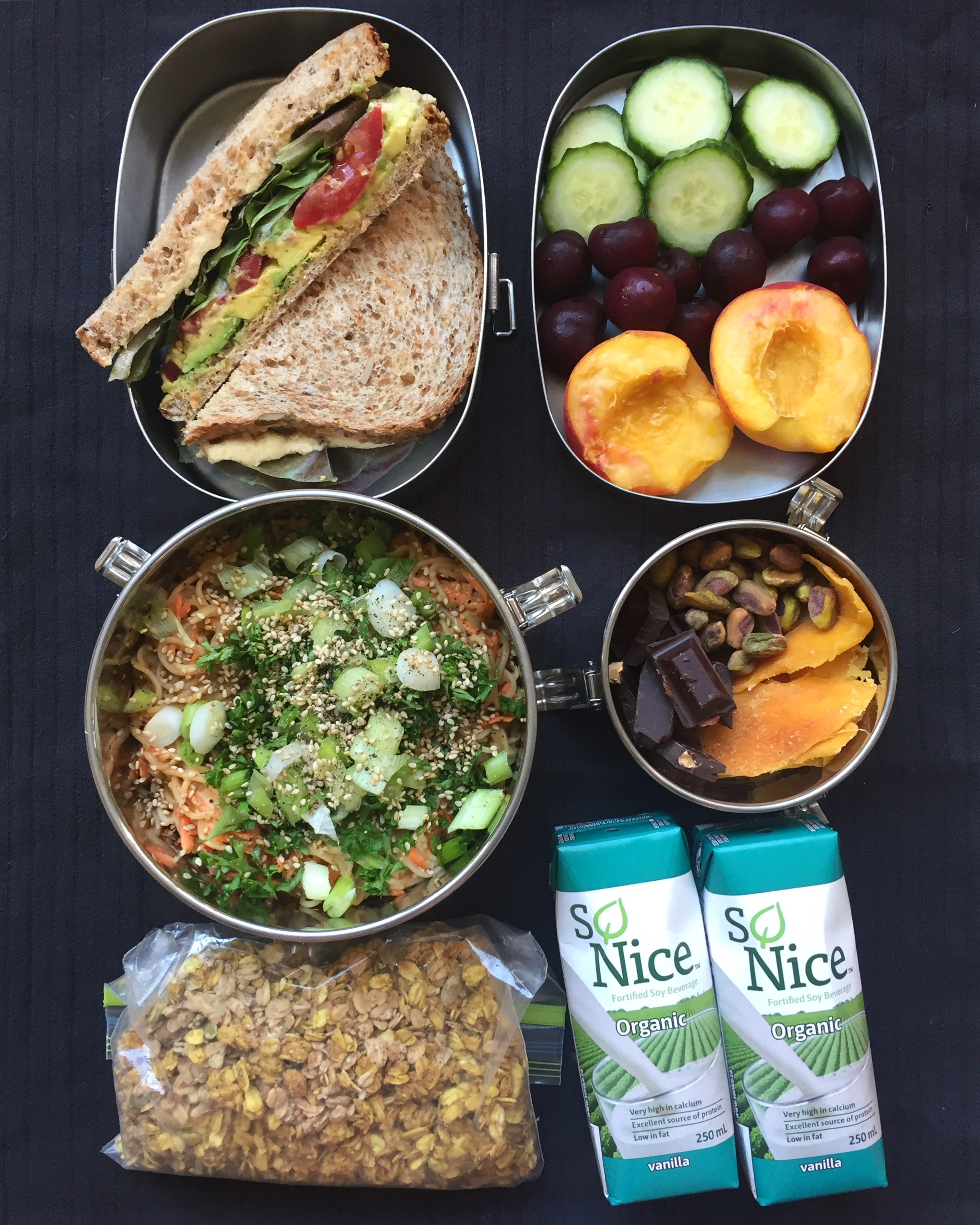 Overnight backcountry food for just me, sans stove: hummus sandwich; cukes, cherries and peach (it was August!), peanut noodles; pistachios, dried mango, dark chocolate; granola with anti-inflammatory turmeric added; tetra pack soy milk