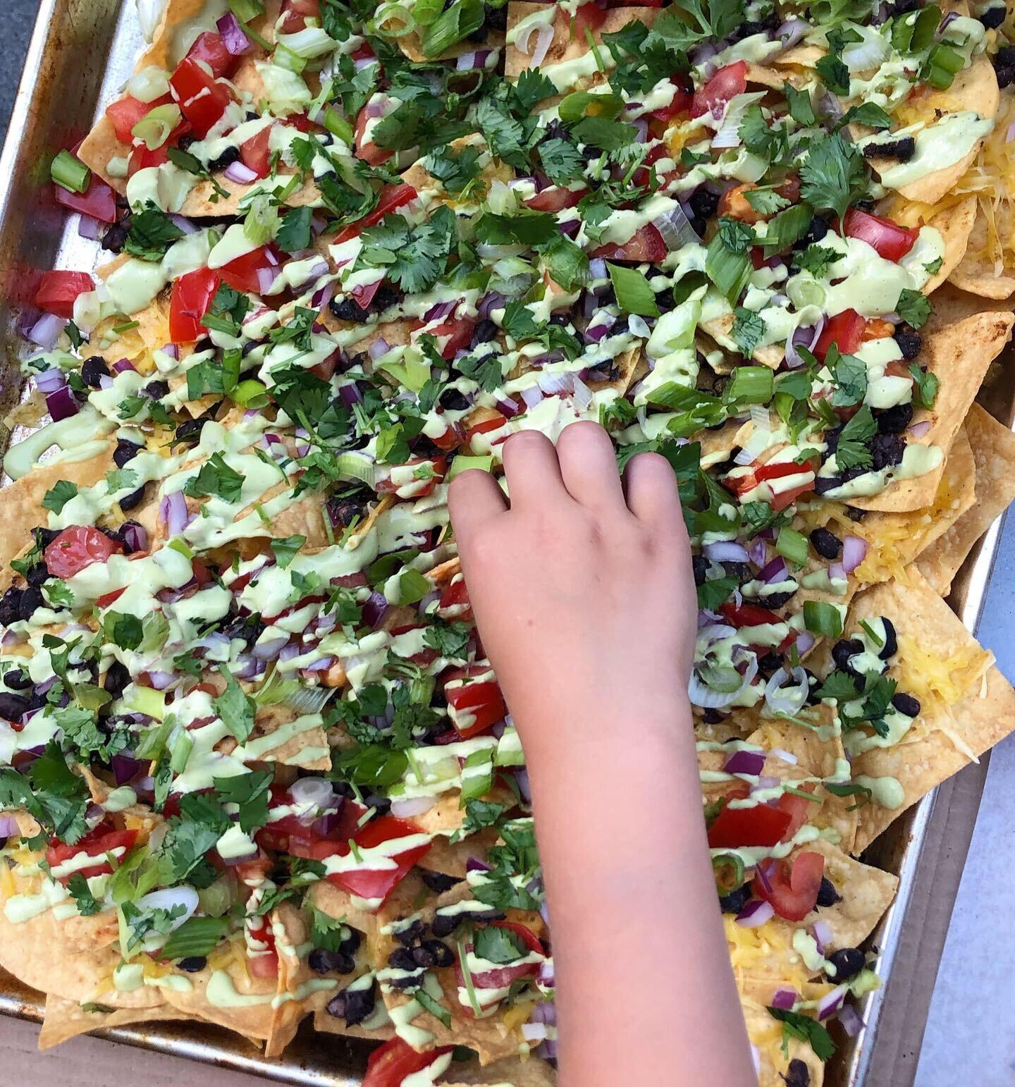 Cilantro-lime cream is great on nachos. Recipe  here .
