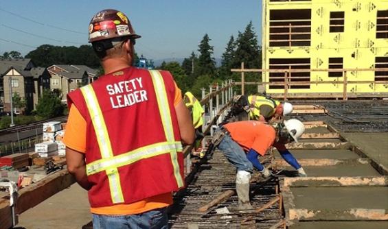 Red Vest Concrete Safety Leader