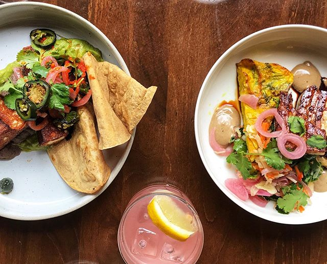 Laura's hand-made strawberry drinking vinegar sitting pretty in the front! Fabian's Guasacaca with grilled halloumi to the left and Martijn's cabbage omelette with soy-glazed pork belly on the right. ⠀⠀ 📷 Thank you to @jme.low | @nna.jme_studio