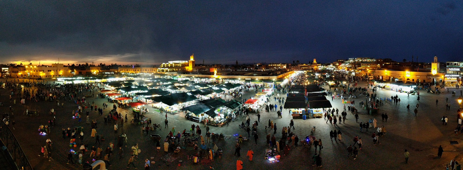 "The Jemaa el Fna, the big giant square full of food stalls, performances, snake charmers, monkey handlers, boxing matches and just the entire spectacle, is the focal point of it all. ""Quieter"" during the day and comes alive by sunset. Photo taken with Google Pixel."