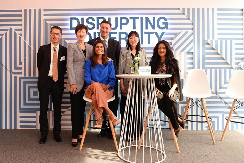 Manpower Minister Josephine Teo (second from left) and CNN journalist Manisha Tank (centre), who moderated the discussion, with (from left) StanChart Singapore CEO Patrick Lee; Mr Simon Cooper, StanChart's chief executive for corporate, commercial and institutional banking; Ms Deborah Ho, managing director and head of South-east Asia at BlackRock; and Dr Ayesha Khanna, CEO of Addo AI.PHOTO: STANDARD CHARTERED BANK