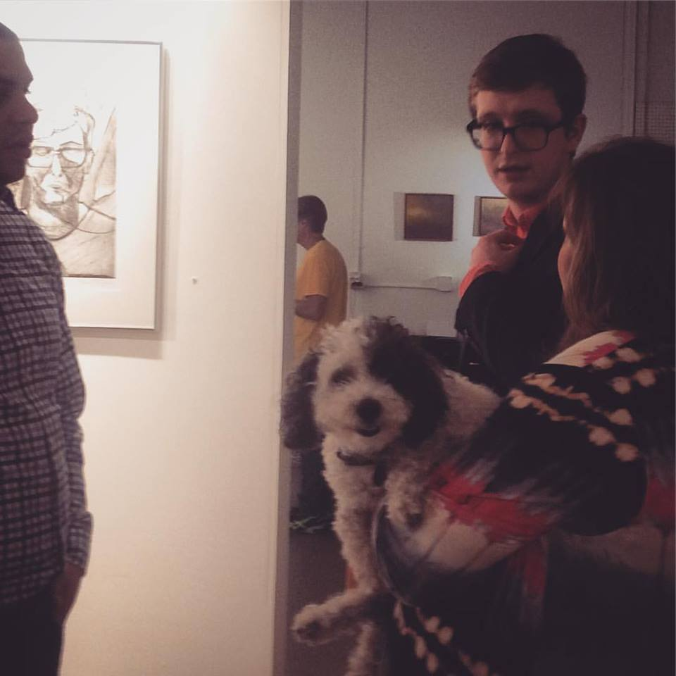 Anthony Birchfield, Micah Zavacky, and Jan Brandt with dog.