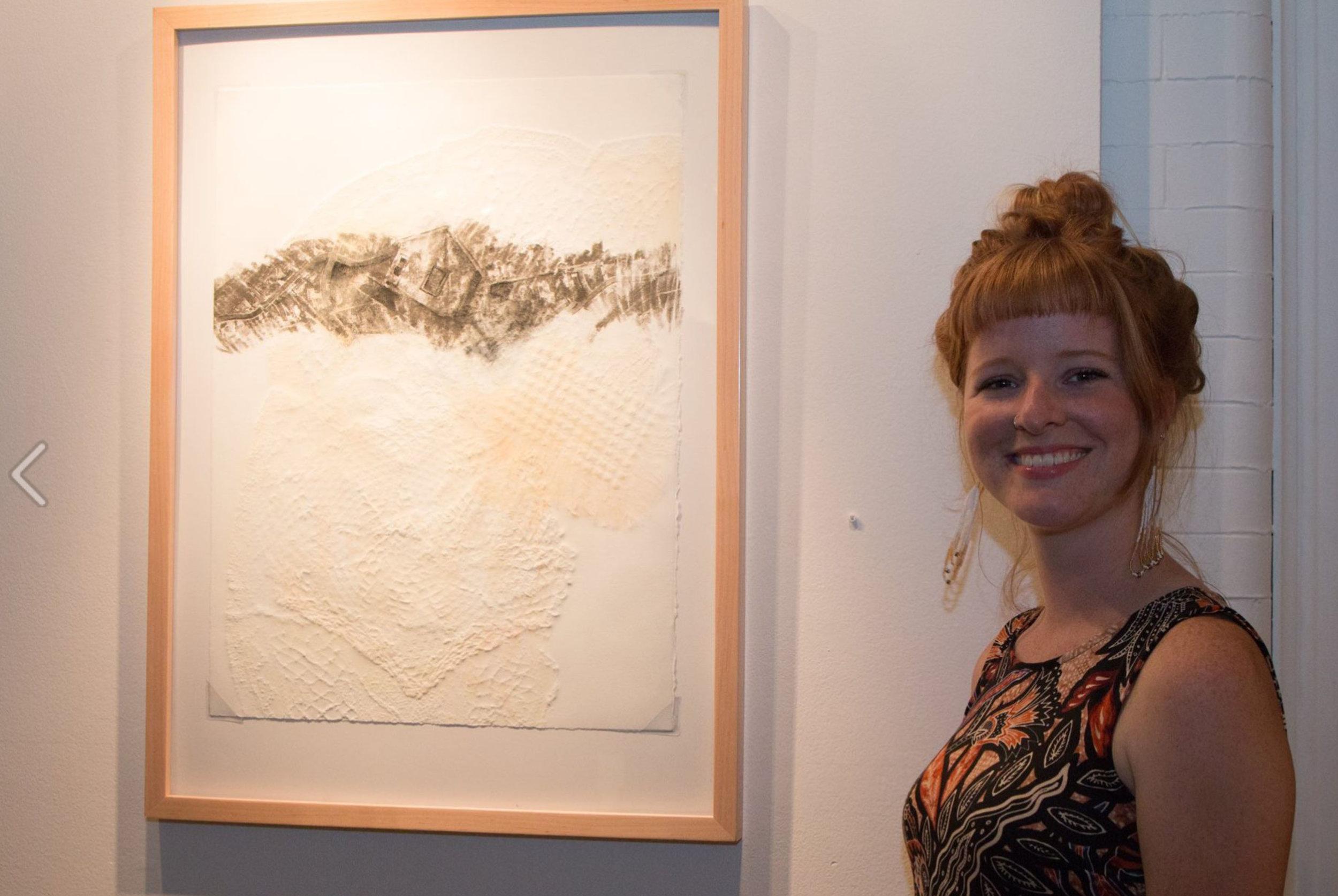 Graduate student Molly Markow poses alongside her work. Photo Courtesy: Justine Kaszynski Photography