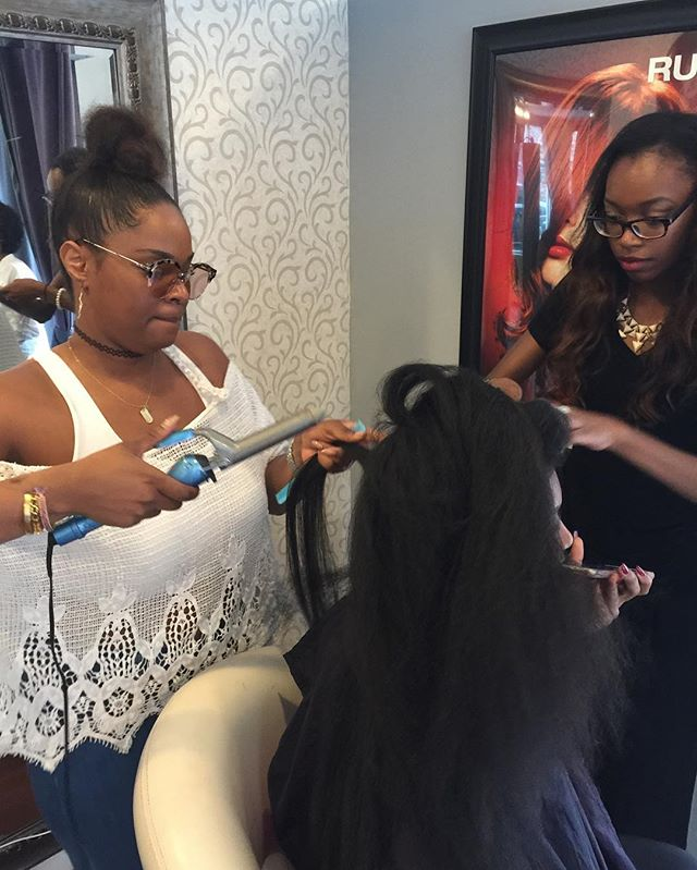 Vanity Studio Student assisting @crownedbyqueenv as she pin curl sets her prom Queen #BeautySchool #VanityStudio