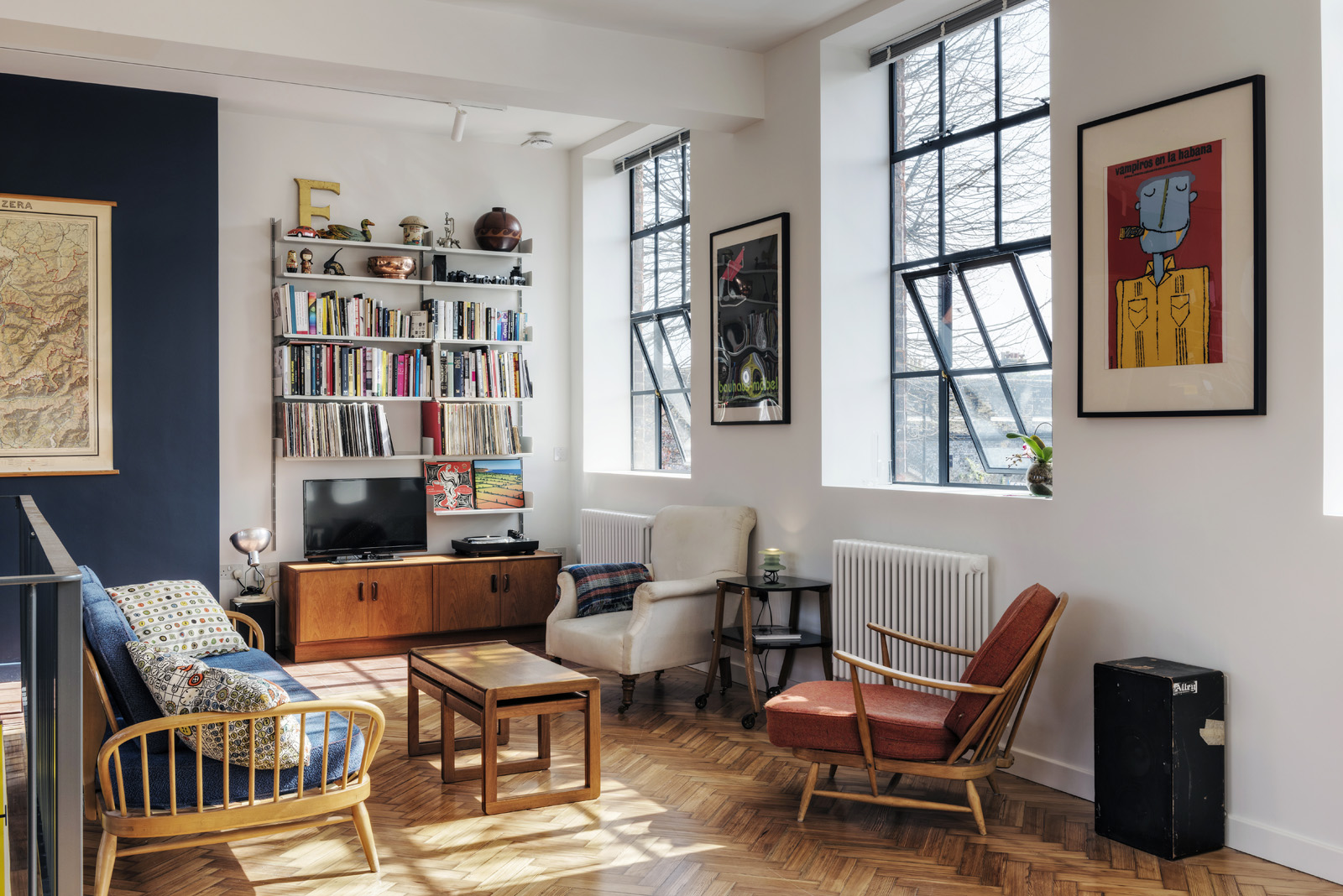 The original parquet flooring was refurbished and period-correct steel framed windows reinstated.