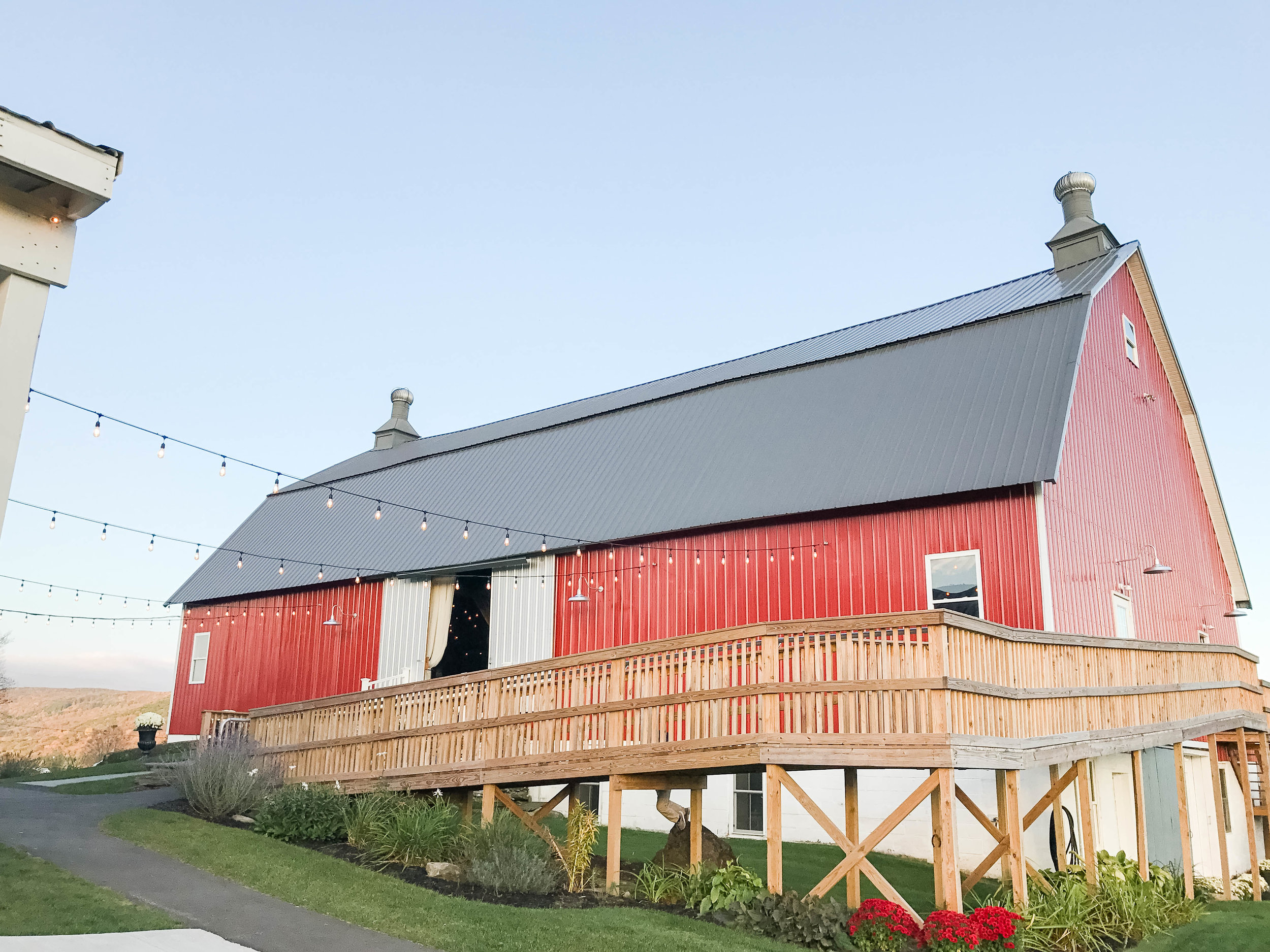 the Big Red Barn with string lights for wedding at Farm at Cottrell Lake by Elk Mountain Ski Resort