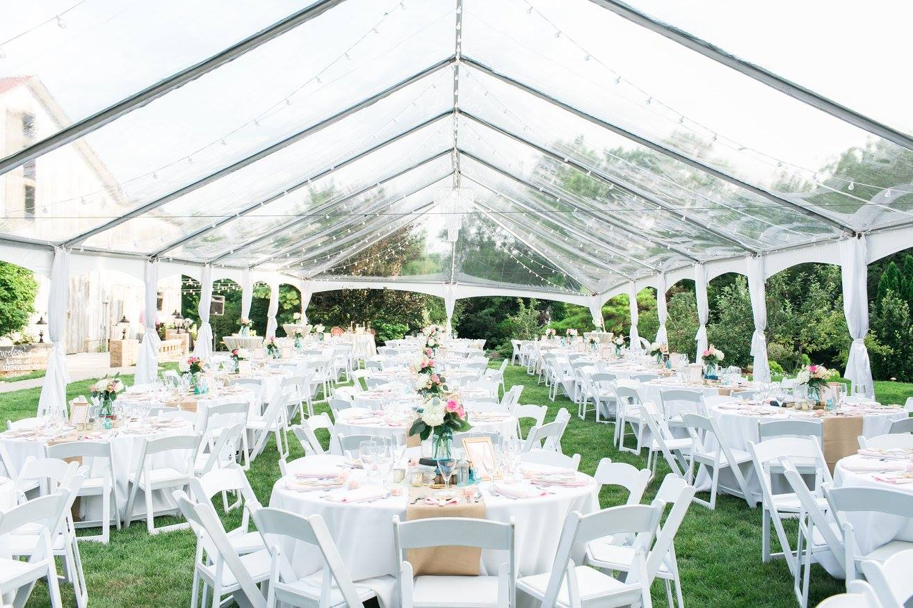 The tent for our 250 guests! The clear tent allowed for beautiful lighting, being able to watch the sunset and didn't block the barn!
